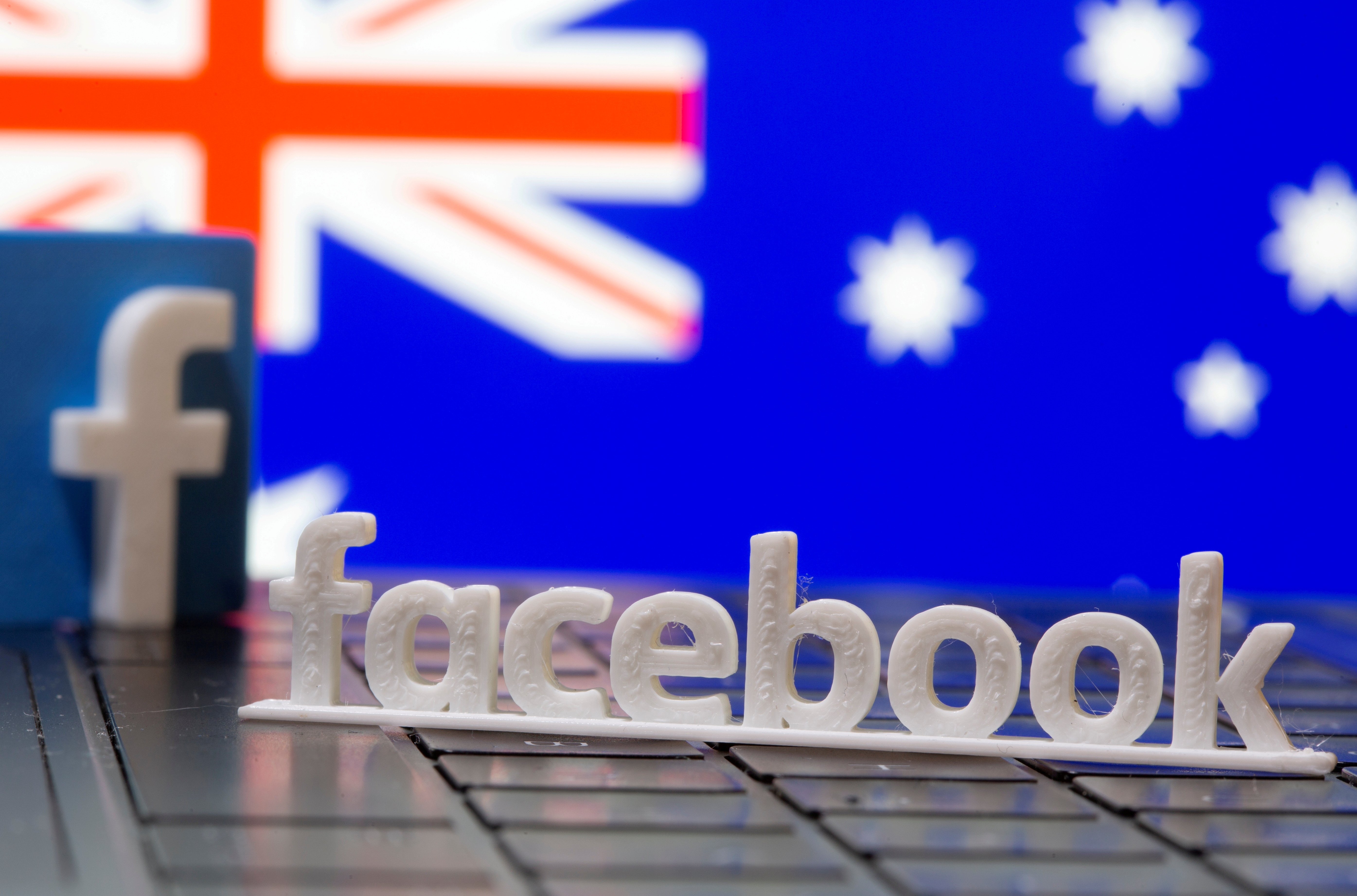 A 3D printed Facebook logo is seen in front of displayed Australia's flag in this illustration photo taken February 18, 2021. REUTERS/Dado Ruvic/Illustration/File Photo