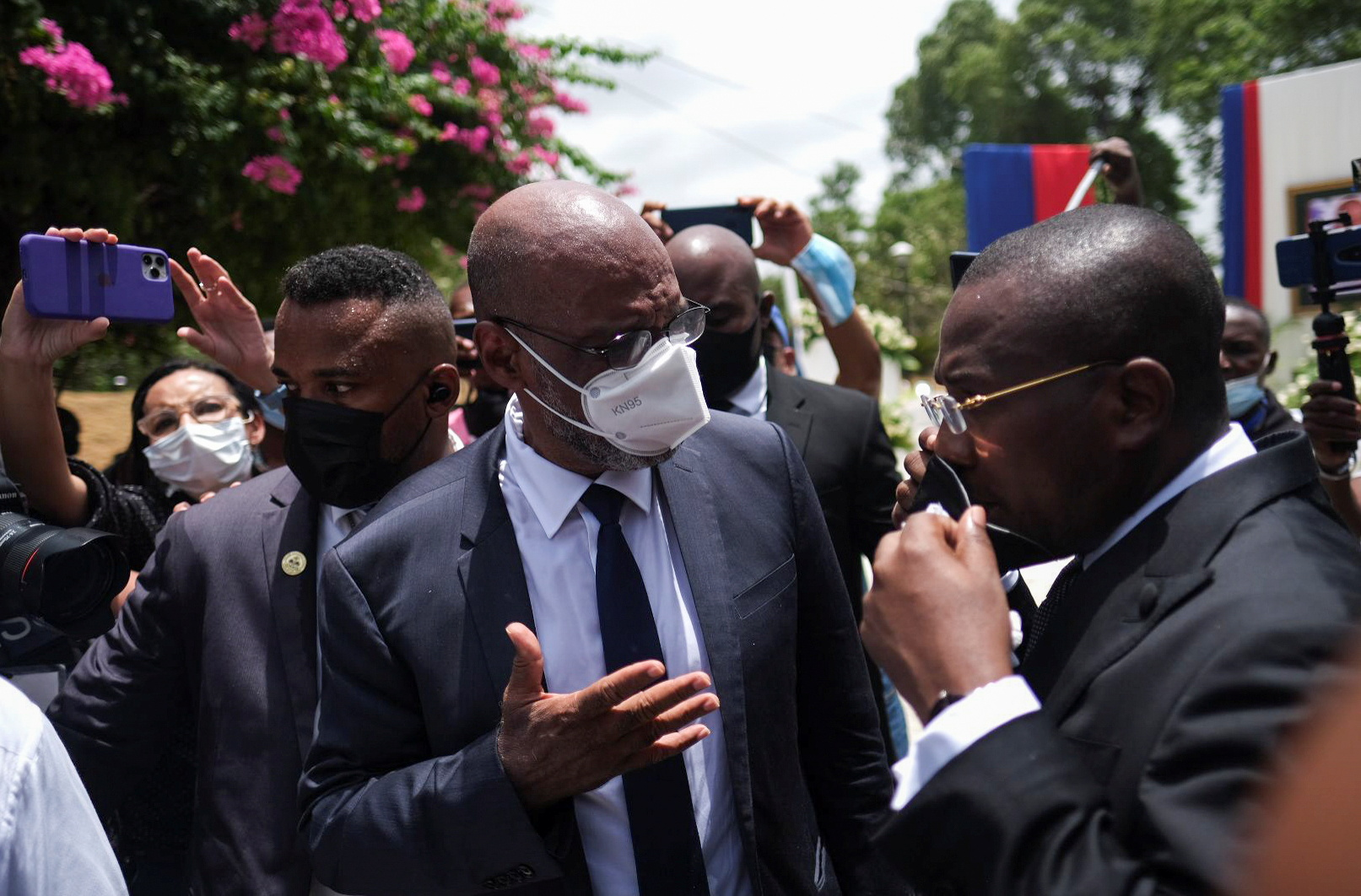 Haiti's interim Prime Minister Claude Joseph and Ariel Henry, tapped by late Haitian President Jovenel Moise to be the new prime minister just days before he was assassinated, chat at the official memorial services for Moise, in Port-au-Prince, Haiti July 20, 2021. REUTERS/Ricardo Arduengo