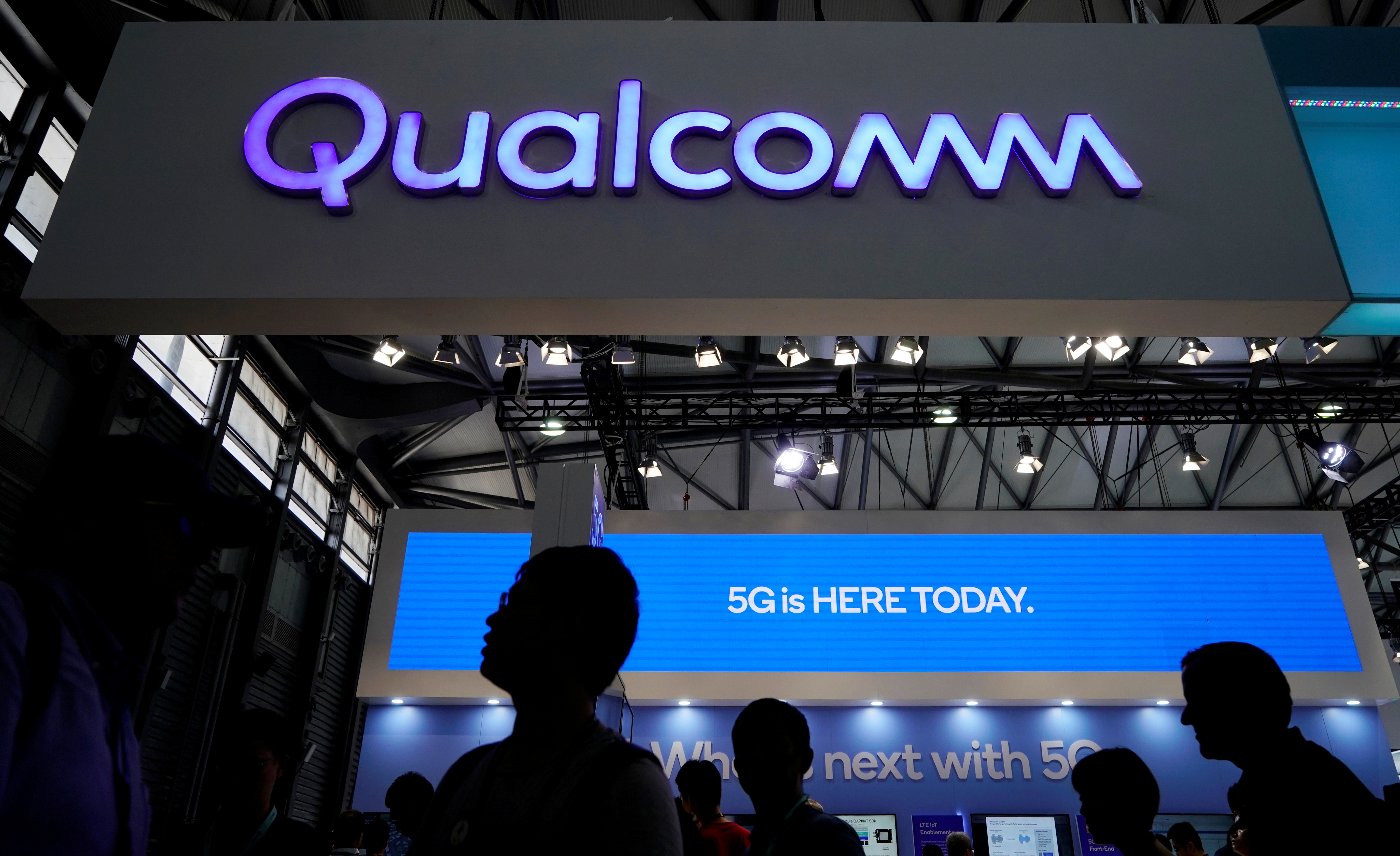 File photo: A Qualcomm sign is pictured at the Mobile World Congress in Shanghai, China June 28, 2019. REUTERS/Aly Song