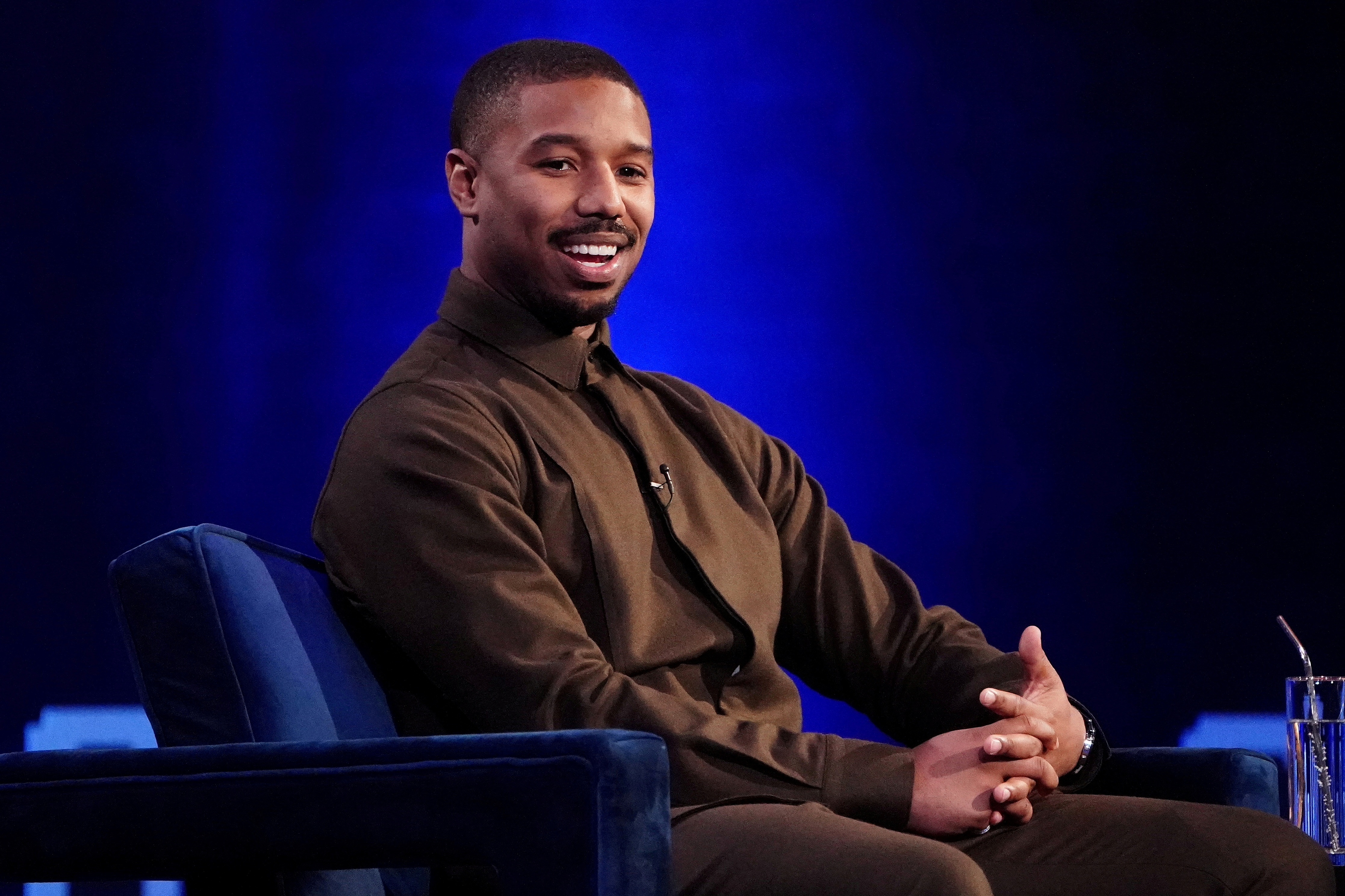 Actor Michael B. Jordan speaks with Oprah Winfrey on stage during a taping of her TV show in the Manhattan borough of New York City, New York, U.S., February 5, 2019. REUTERS/Carlo Allegri/File Photo