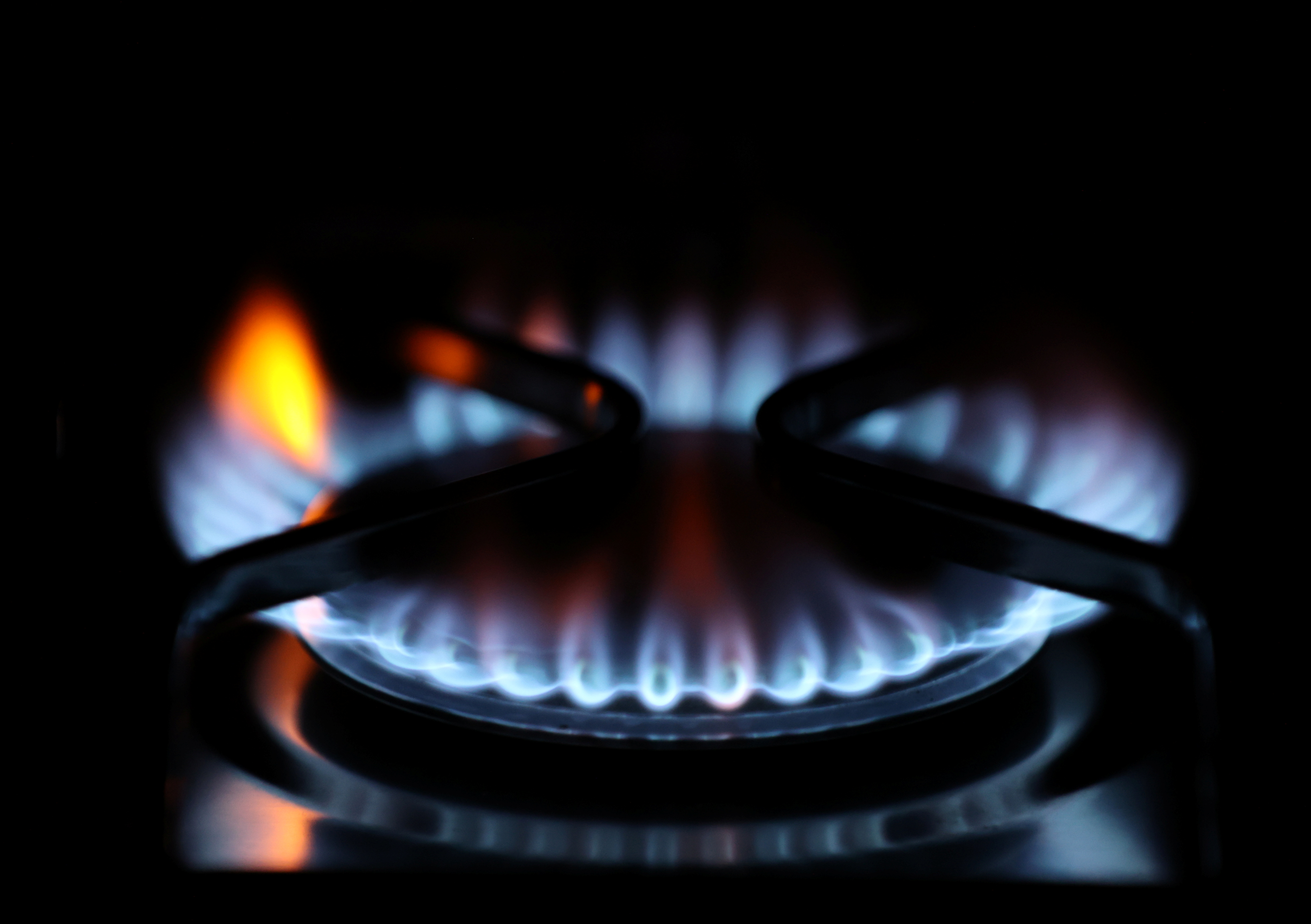 Flames come out of a domestic gas ring of an oven in Durham, Britain, September 23, 2021. REUTERS/Lee Smith