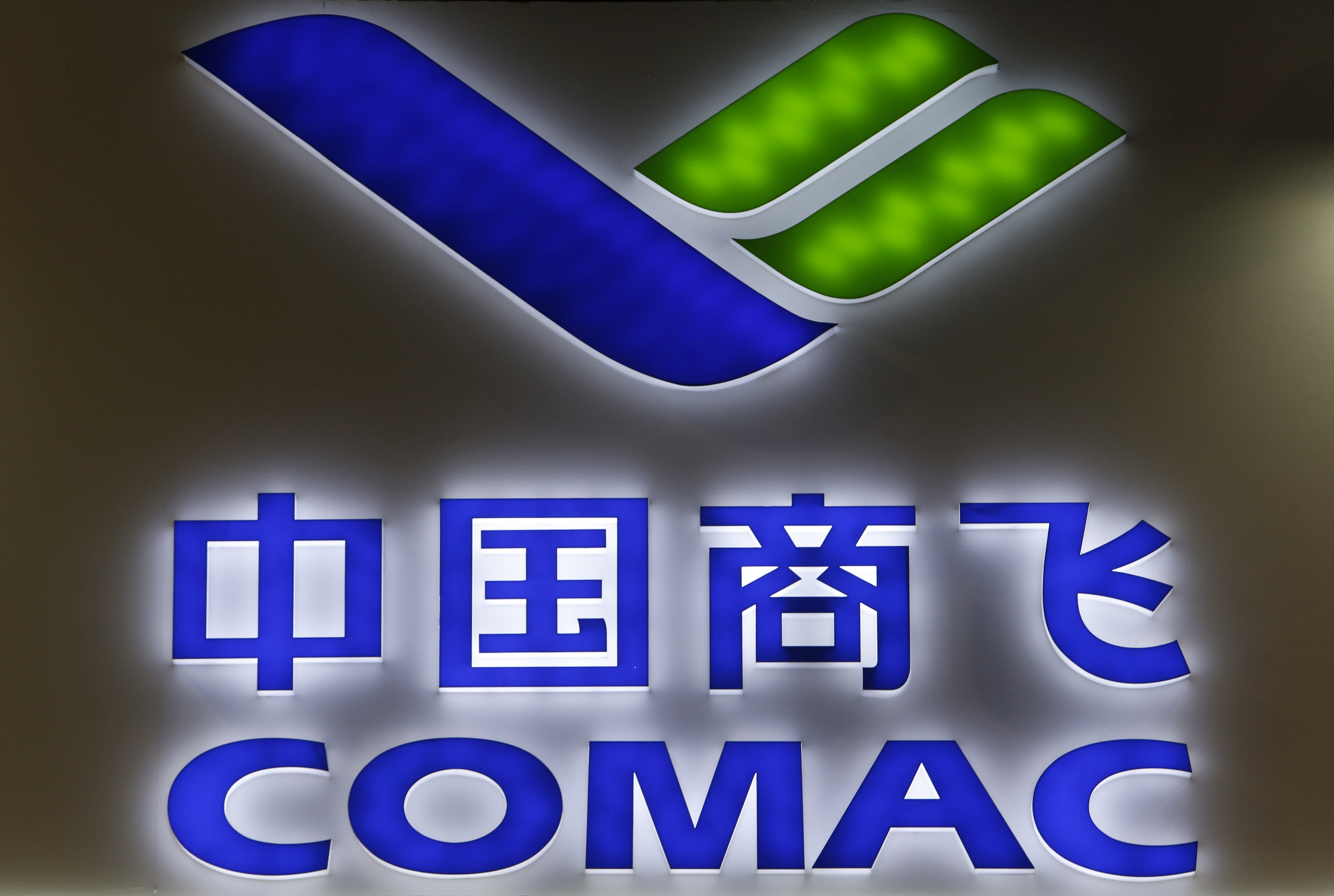 A Commercial Aircraft Corporation of China (COMAC) logo is pictured at their booth at the Singapore Airshow February 12, 2014. REUTERS/Edgar Su/File Photo