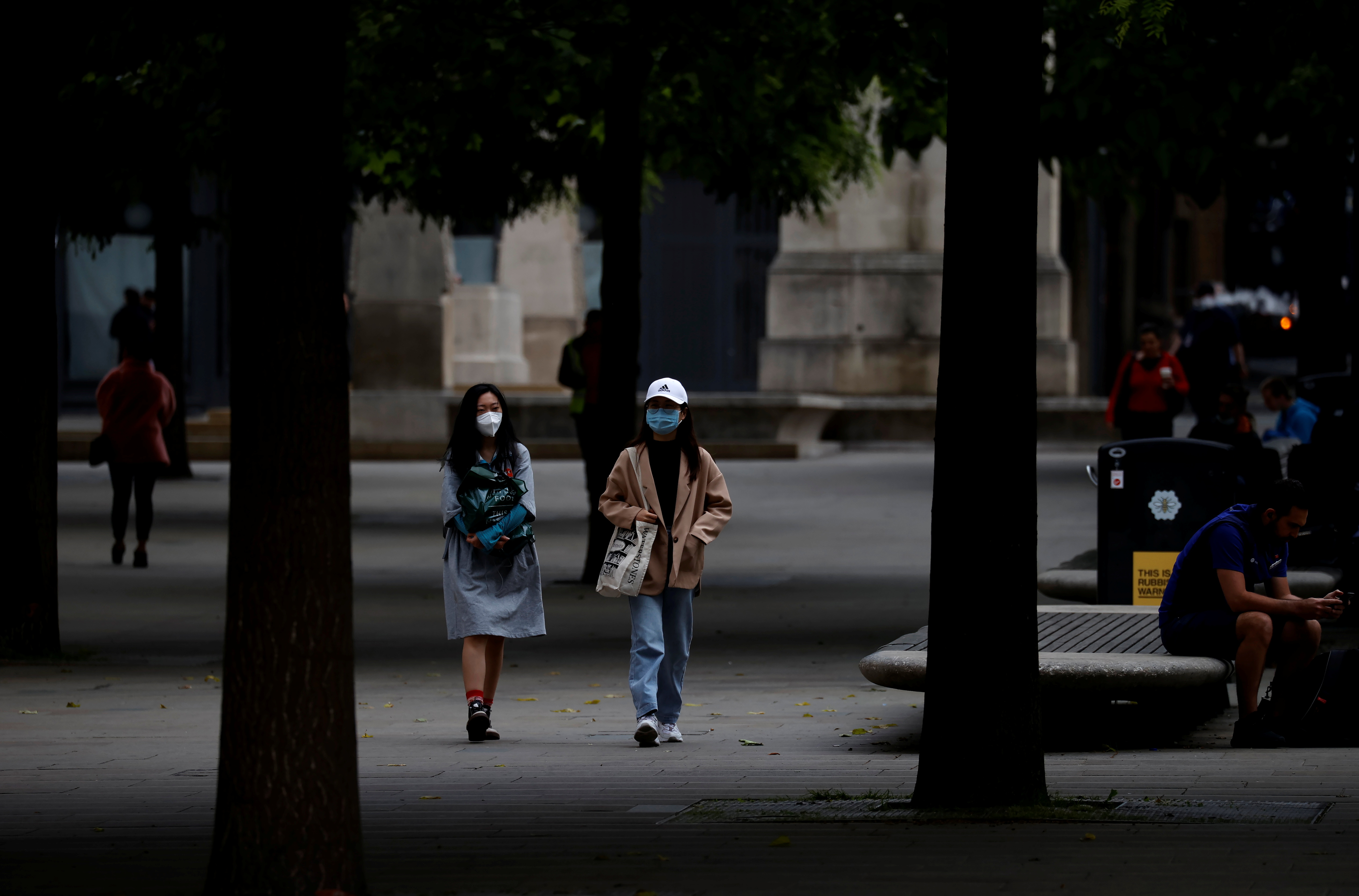 People wear protective masks as they walk through the city centre, amid the outbreak of the coronavirus disease (COVID-19) in Manchester, Britain, June 21, 2021. REUTERS/Phil Noble