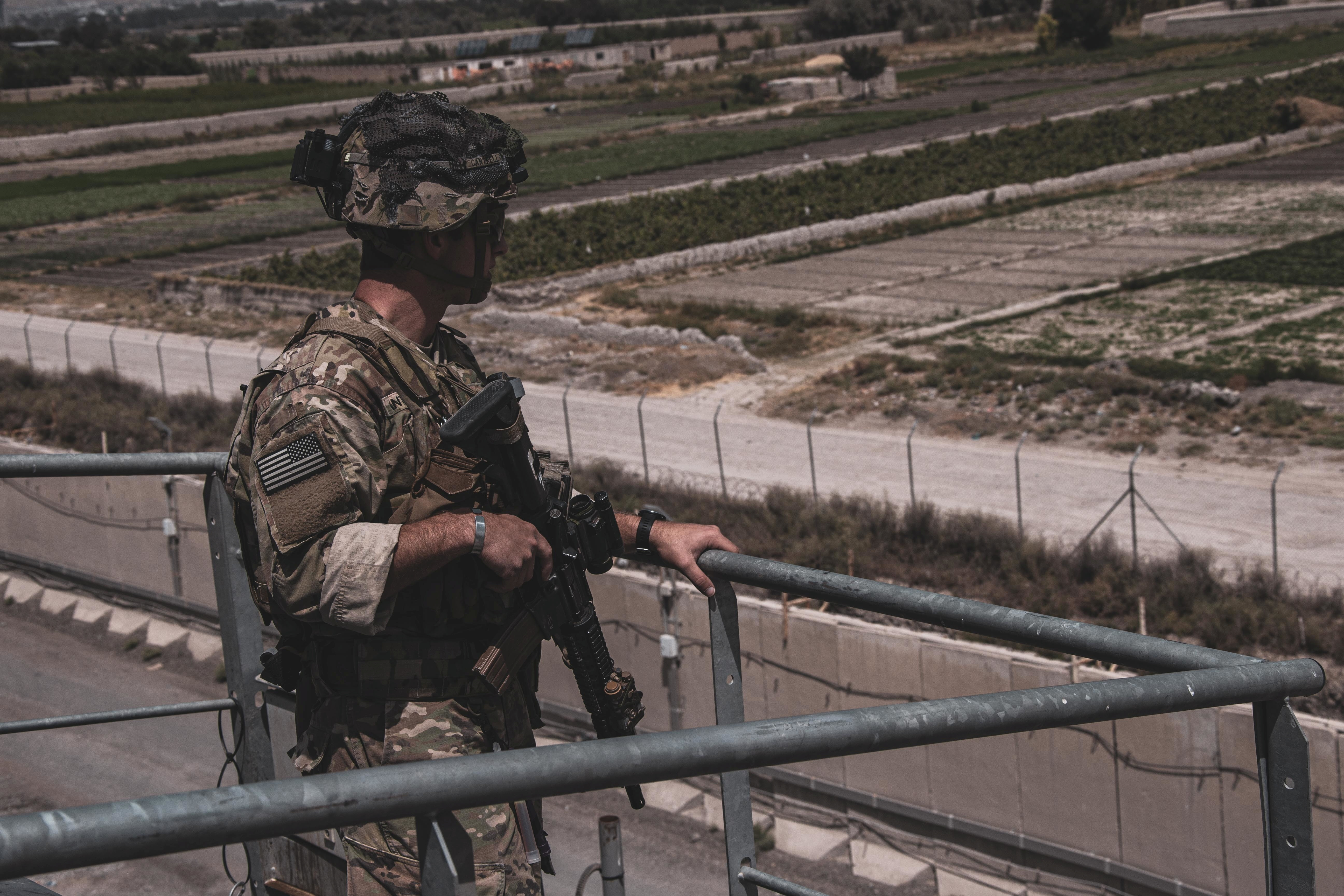 A soldier assigned to the 82nd Airborne Division provides security at Hamid Karzai International Airport, Afghanistan, August 21, 2021. Picture taken August 21, 2021.  U.S. Marine Corps/Cpl. Davis Harris/Handout via REUTERS