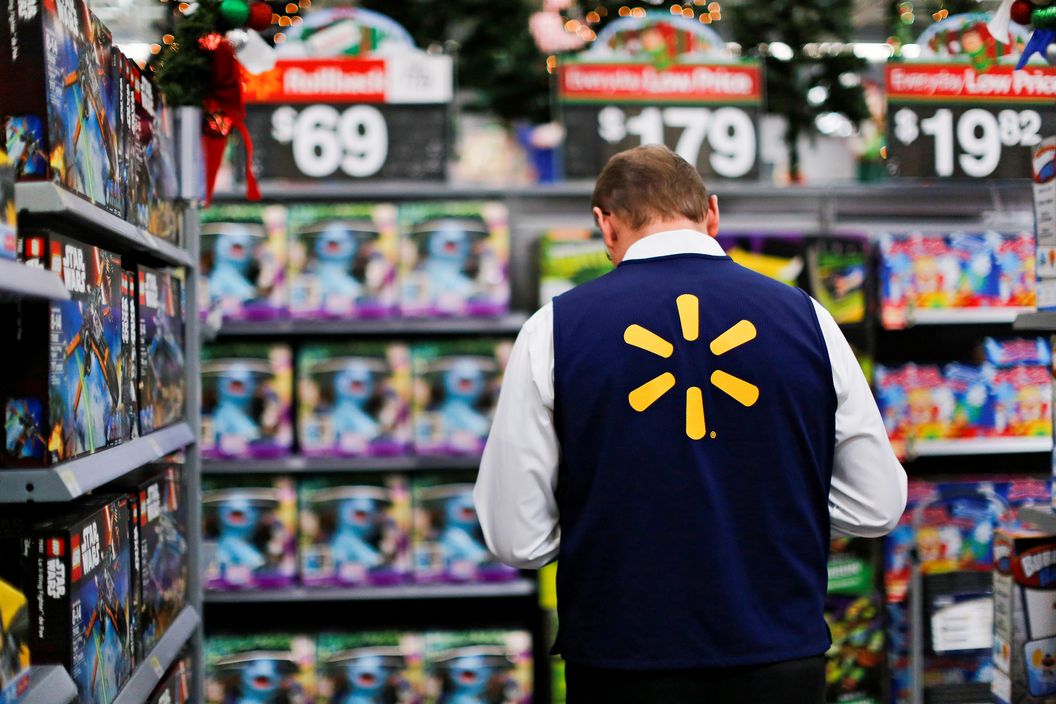 A Walmart worker organises products for Christmas season at a Walmart store in Teterboro, New Jersey, U.S., October 26, 2016. REUTERS/Eduardo Munoz
