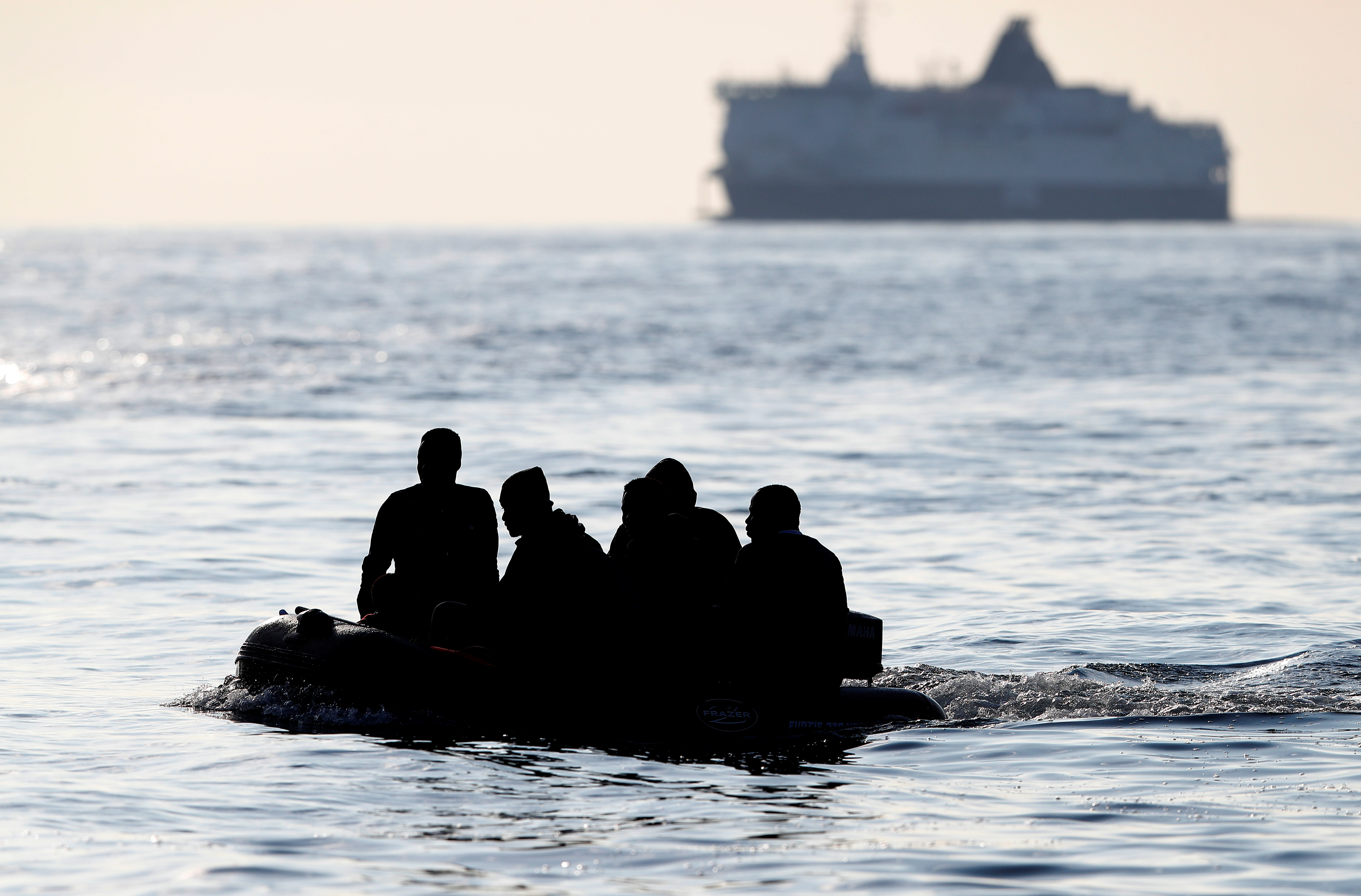 Migrants claiming to be from Darfur, Sudan cross the English Channel in an inflatable boat near Dover, Britain, August 4, 2021. Picture taken August 4, 2021.  REUTERS/Peter Nicholls