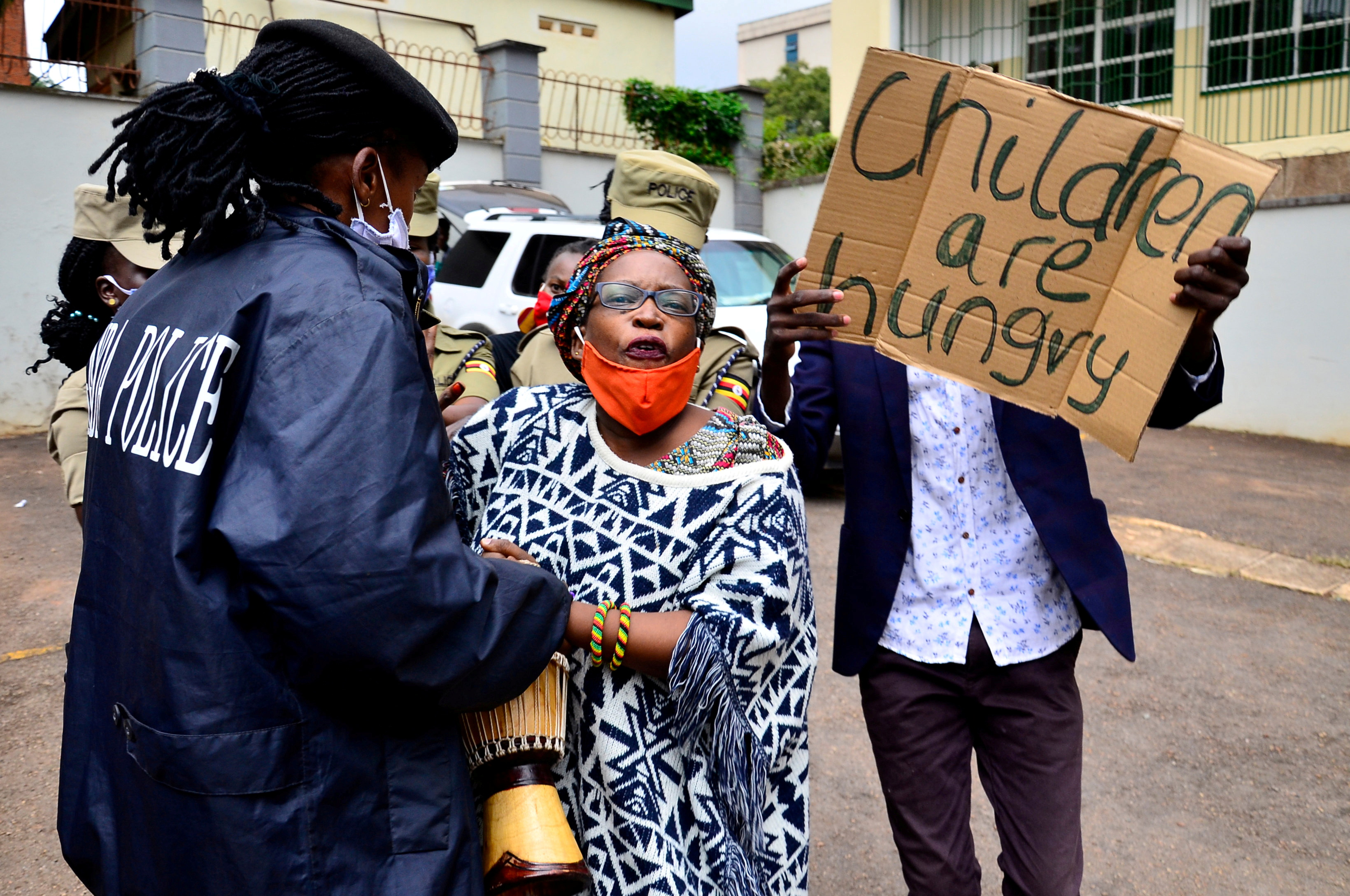 Ugandan academic Stella Nyanzi and activists protest against the way that government distributes the relief food and the lockdown situation to control the spread of the coronavirus disease (COVID-19) outbreak in Kampala, Uganda May 18, 2020. REUTERS/Abubaker Lubowa/File Photo