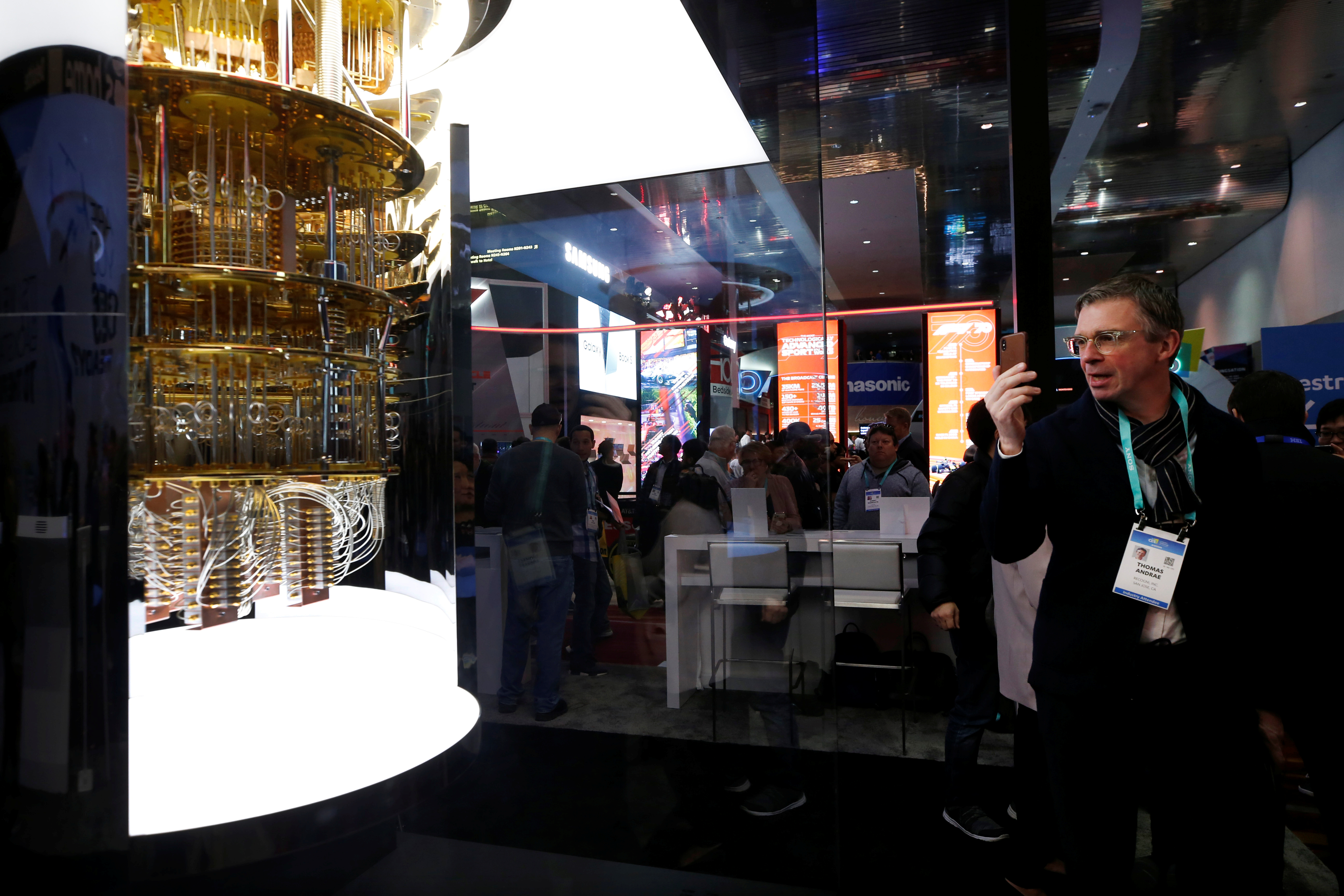 A man takes a photo of a model of the IBM Q System One quantum computer during the 2020 CES in Las Vegas, Nevada, U.S. January 7, 2020. REUTERS/Steve Marcus