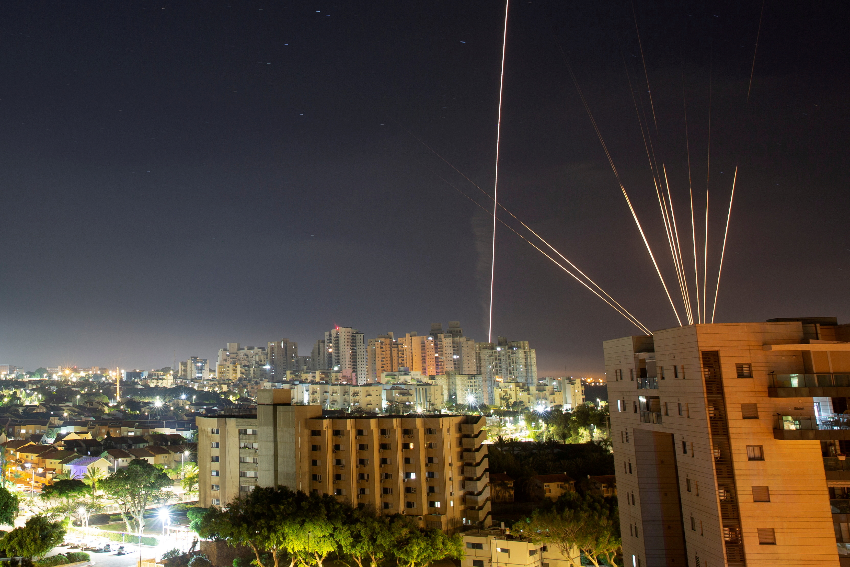 Streaks of lights are seen from Ashkelon as rockets are launched from the Gaza Strip towards Israel, May 15, 2021. REUTERS/Amir Cohen/File Photo