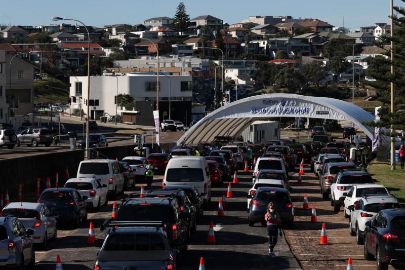 Vehicles wait in line at the Bondi Beach drive-through coronavirus disease (COVID-19) testing centre in the wake of new positive cases in Sydney, Australia, June 17, 2021.  REUTERS/Loren Elliott