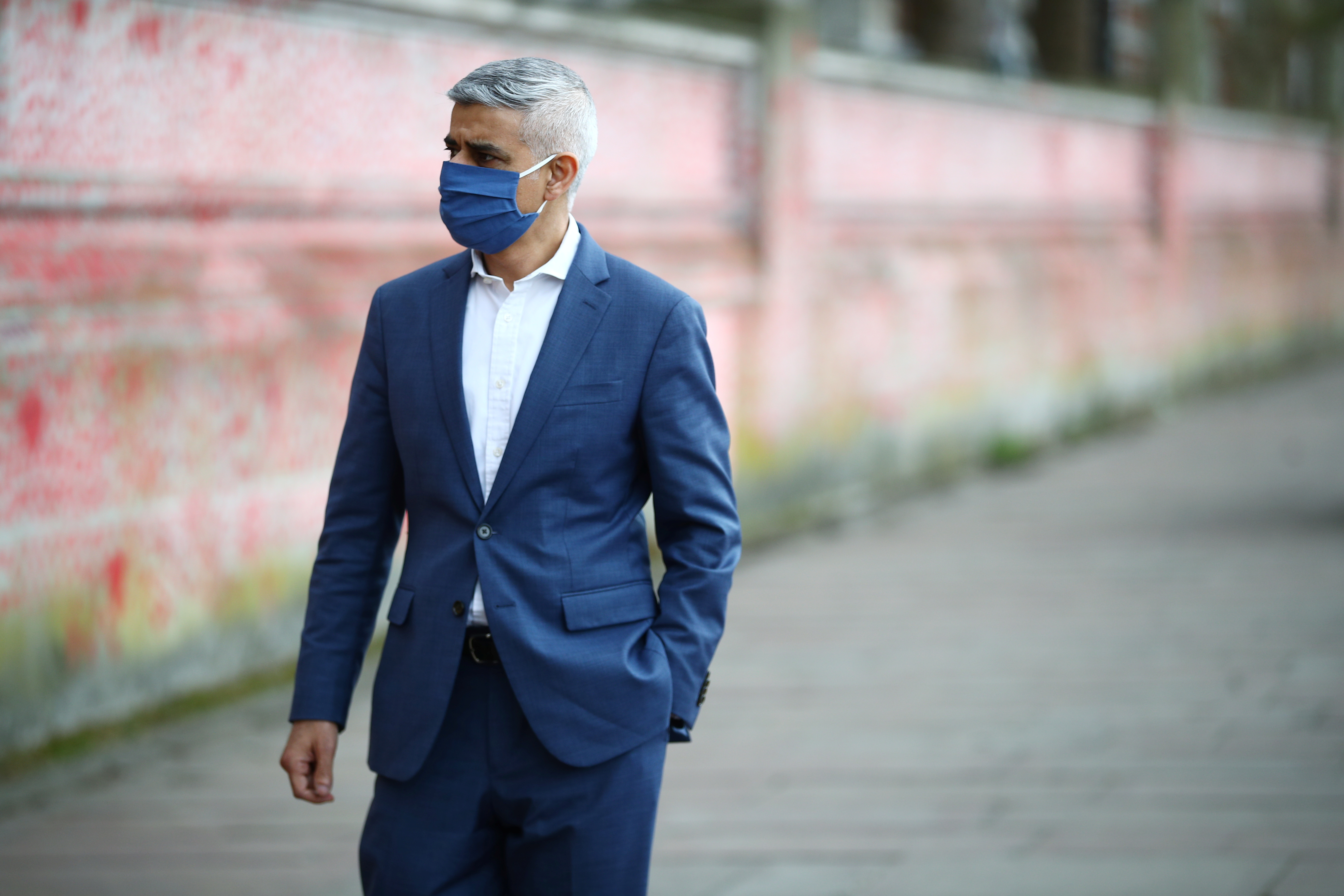 Mayor of London Sadiq Khan walks by  the National Covid Memorial wall beside St Thomas' hospital set as a memorial to all those who have died so far in the UK from the coronavirus disease (COVID-19), amid the coronavirus pandemic in London, Britain April 8, 2021. REUTERS/Hannah McKay