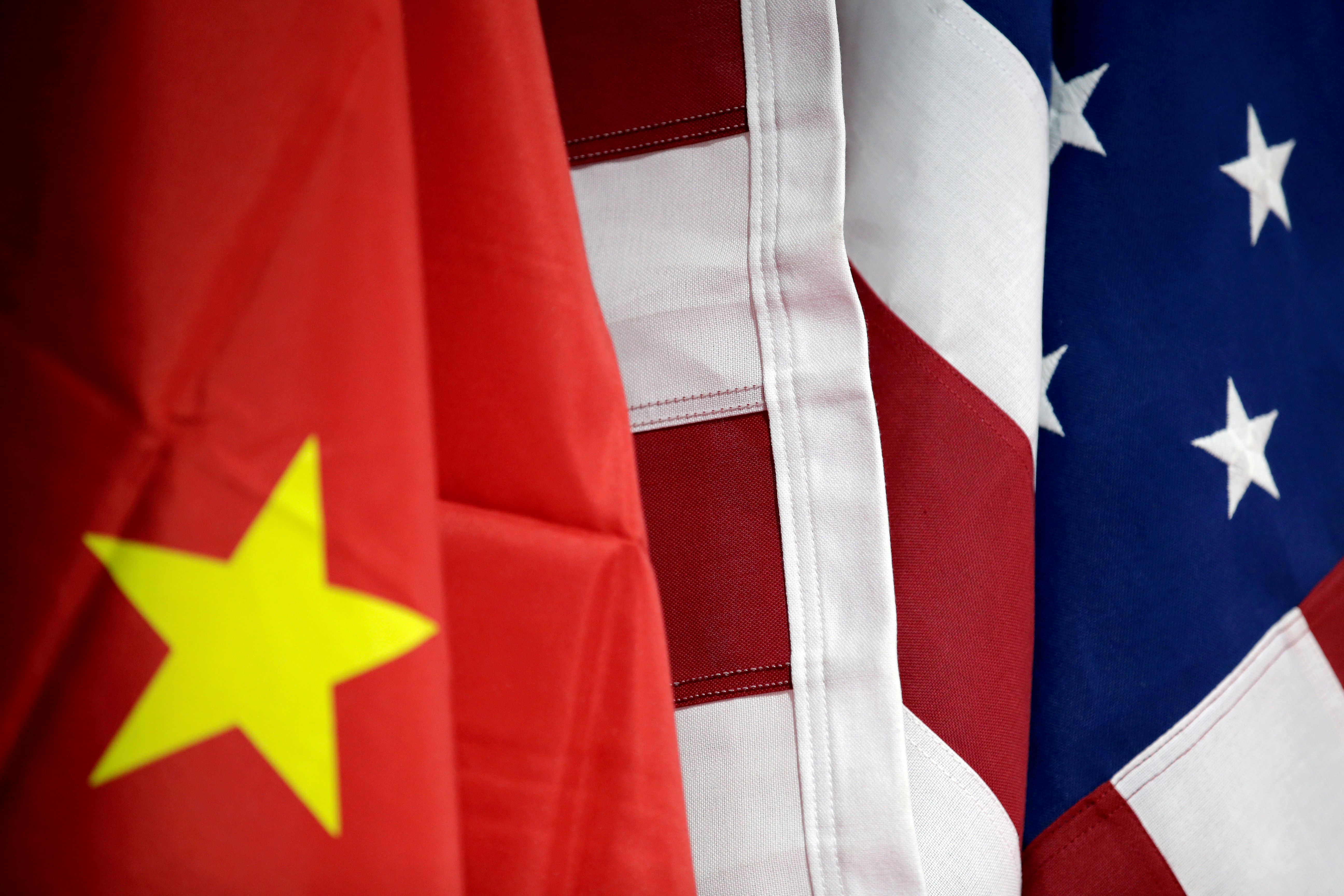 Flags of U.S. and China are displayed at American International Chamber of Commerce (AICC)'s booth during China International Fair for Trade in Services in Beijing, China, May 28, 2019. REUTERS/Jason Lee