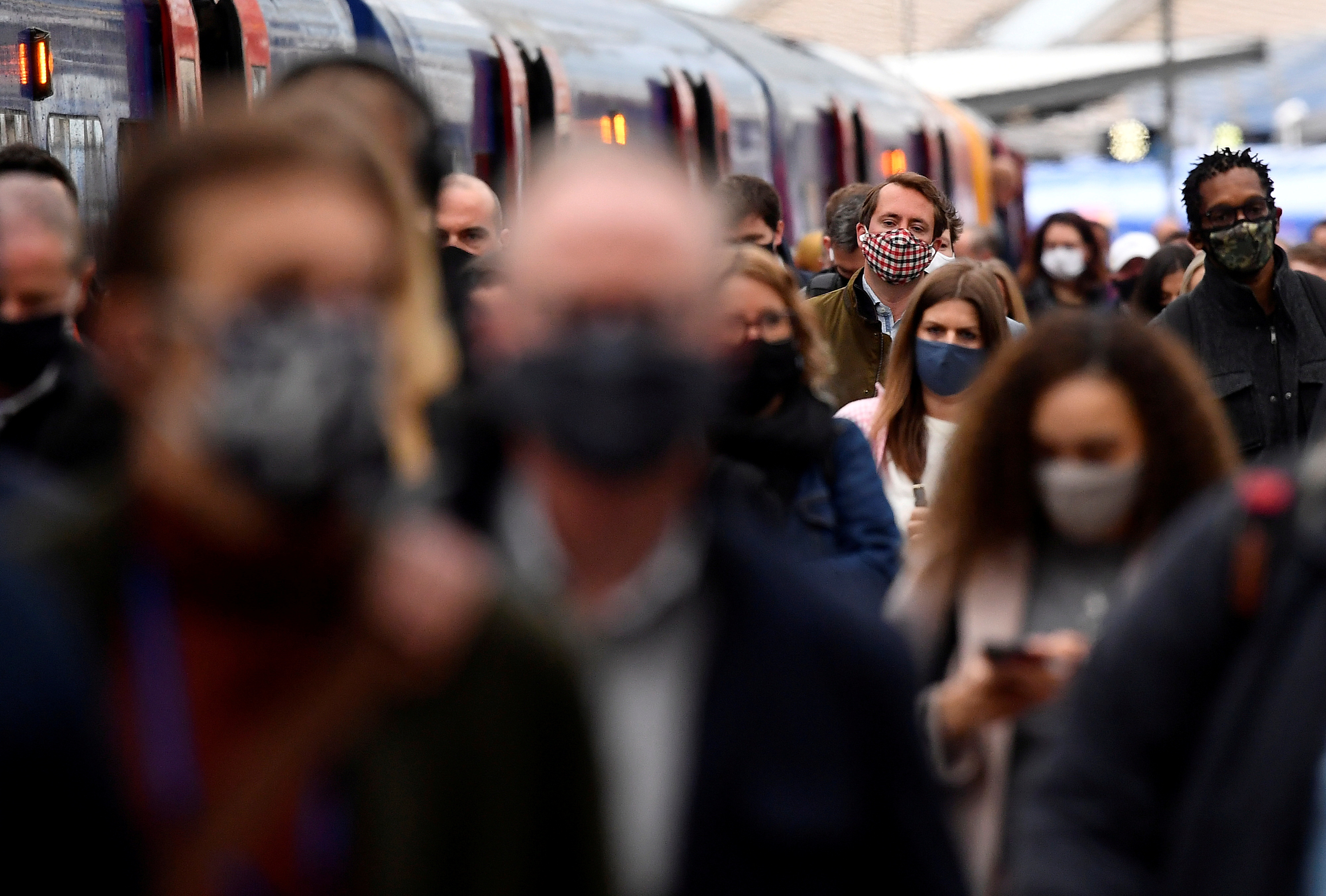 People travel through Waterloo railway station during the morning rush hour as coronavirus disease (COVID-19) restrictions continue to ease throughout the country, London, Britain, May 19, 2021. REUTERS/Toby Melville/File Photo