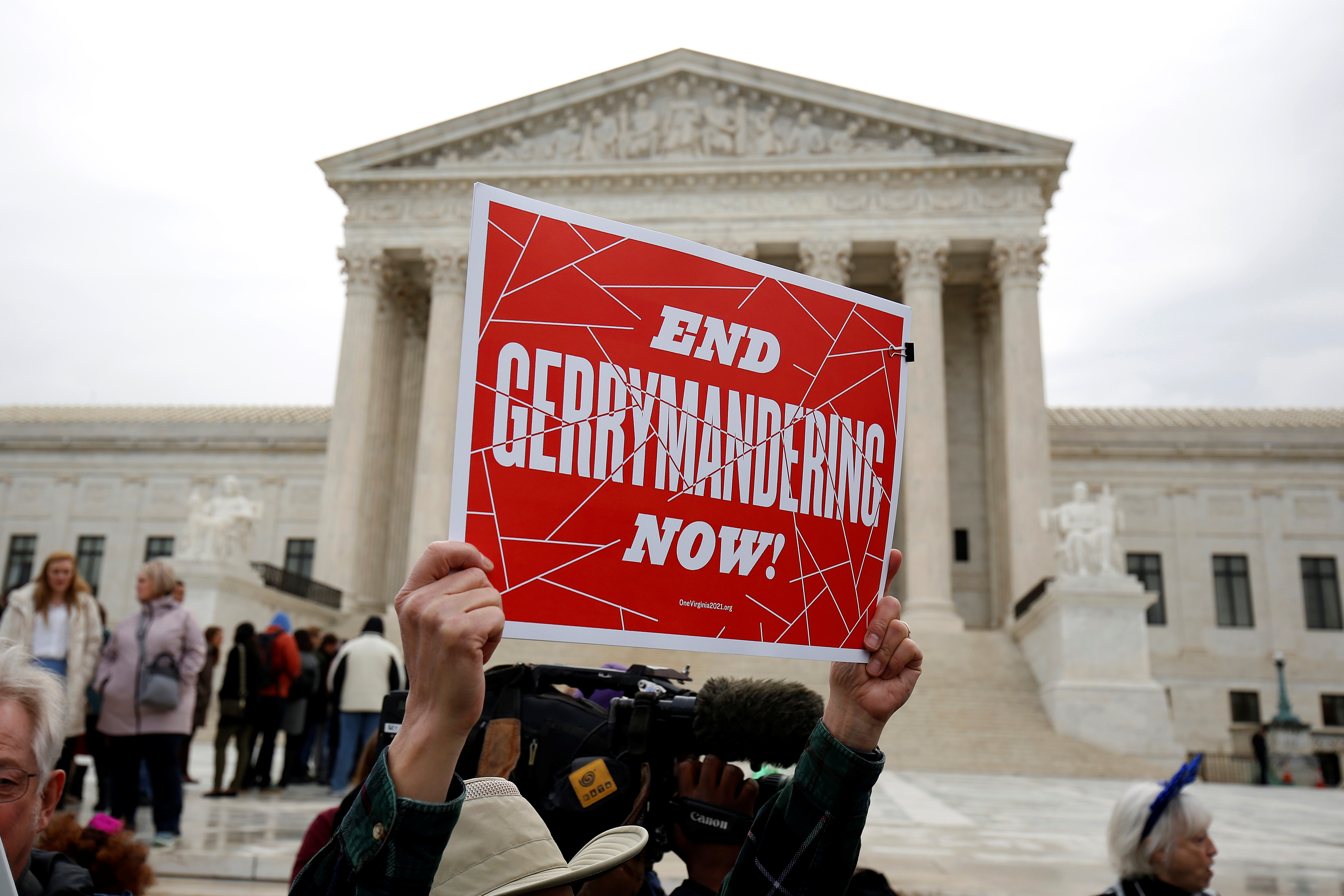 Demonstrators rally in front of the Supreme court before oral arguments on Benisek v. Lamone, a redistricting case on whether Democratic lawmakers in Maryland unlawfully drew a congressional district in a way that would prevent a Republican candidate from winning, in Washington, March 28, 2018.      REUTERS/Joshua Roberts