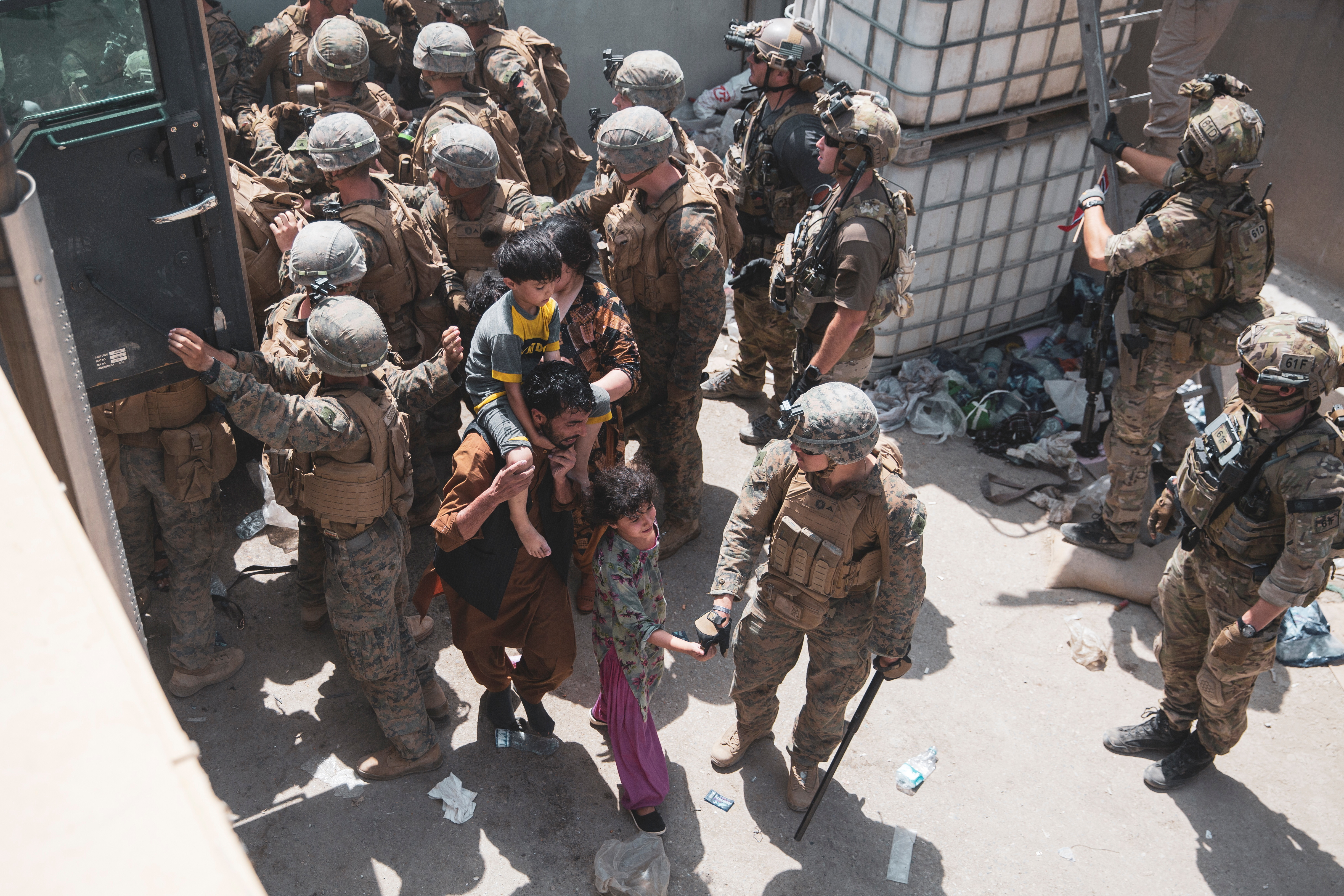 U.S. Marines and Norwegian coalition forces assist with security at an Evacuation Control Checkpoint ensuring evacuees are processed safely during an evacuation at Hamid Karzai International Airport, Kabul, Afghanistan, August 20, 2021.   U.S. Marine Corps/Staff Sgt. Victor Mancilla