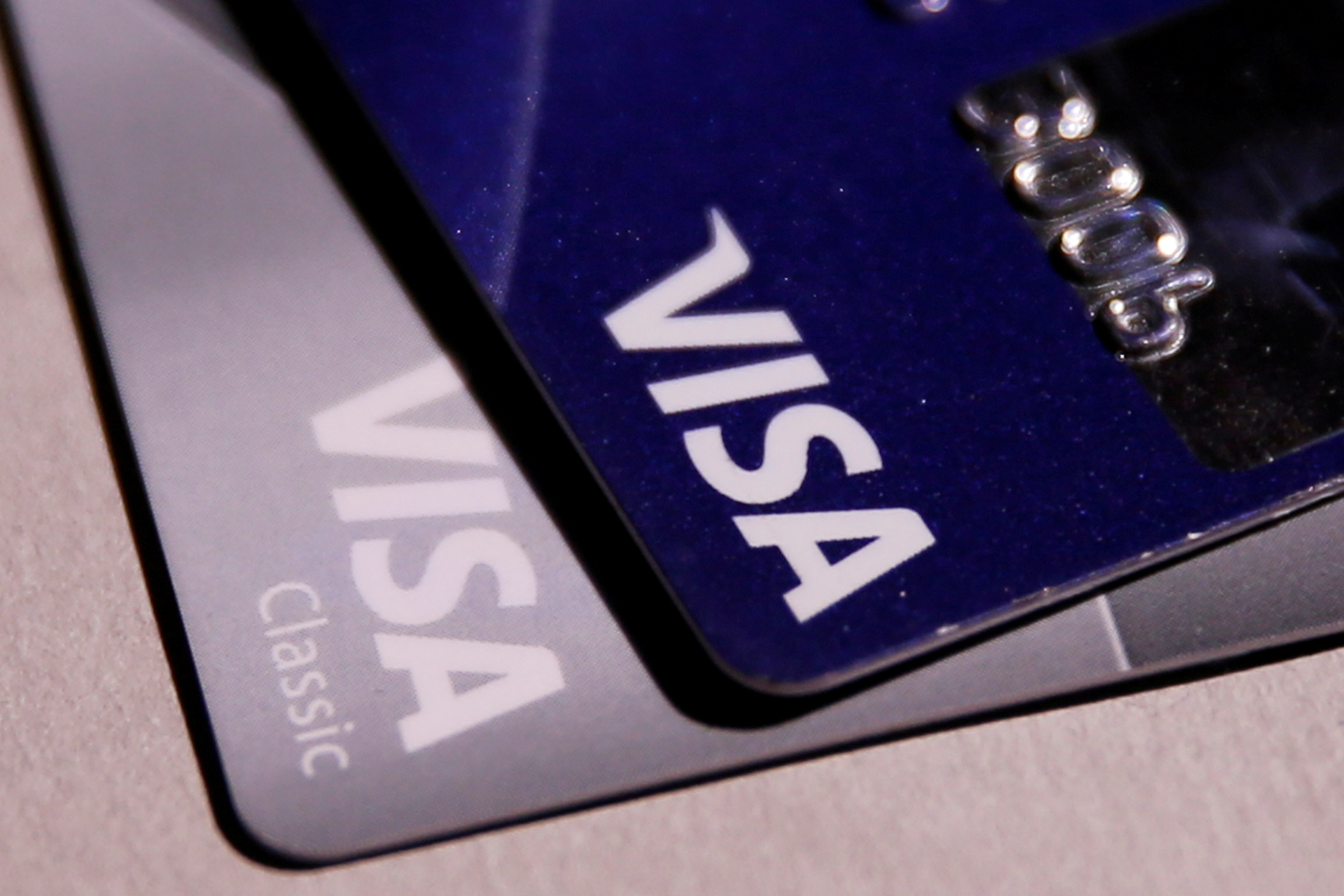 Visa credit cards are seen in this picture illustration taken June 9, 2016. REUTERS/Maxim Zmeyev/Illustration/File Photo   GLOBAL BUSINESS WEEK AHEAD PACKAGE - SEARCH