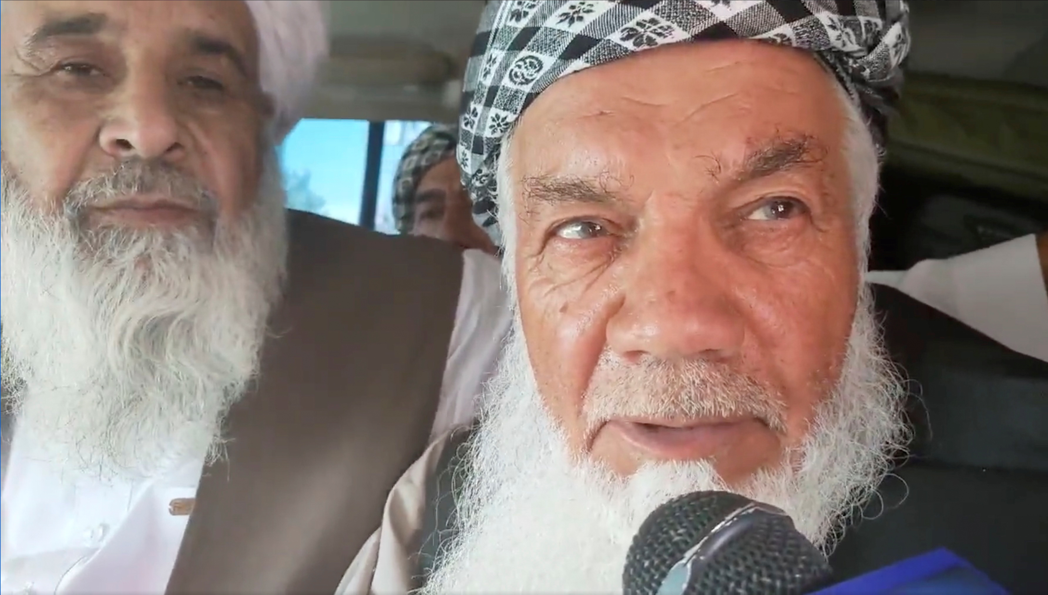 Ismail Khan, a veteran local commander leading militia resistance in Herat, Afghanistan, speaks to a Taliban media arm while in their custody, in this screen grab taken from an undated video from social media uploaded on August 13, 2021. TALIBAN HANDOUT/via REUTERS