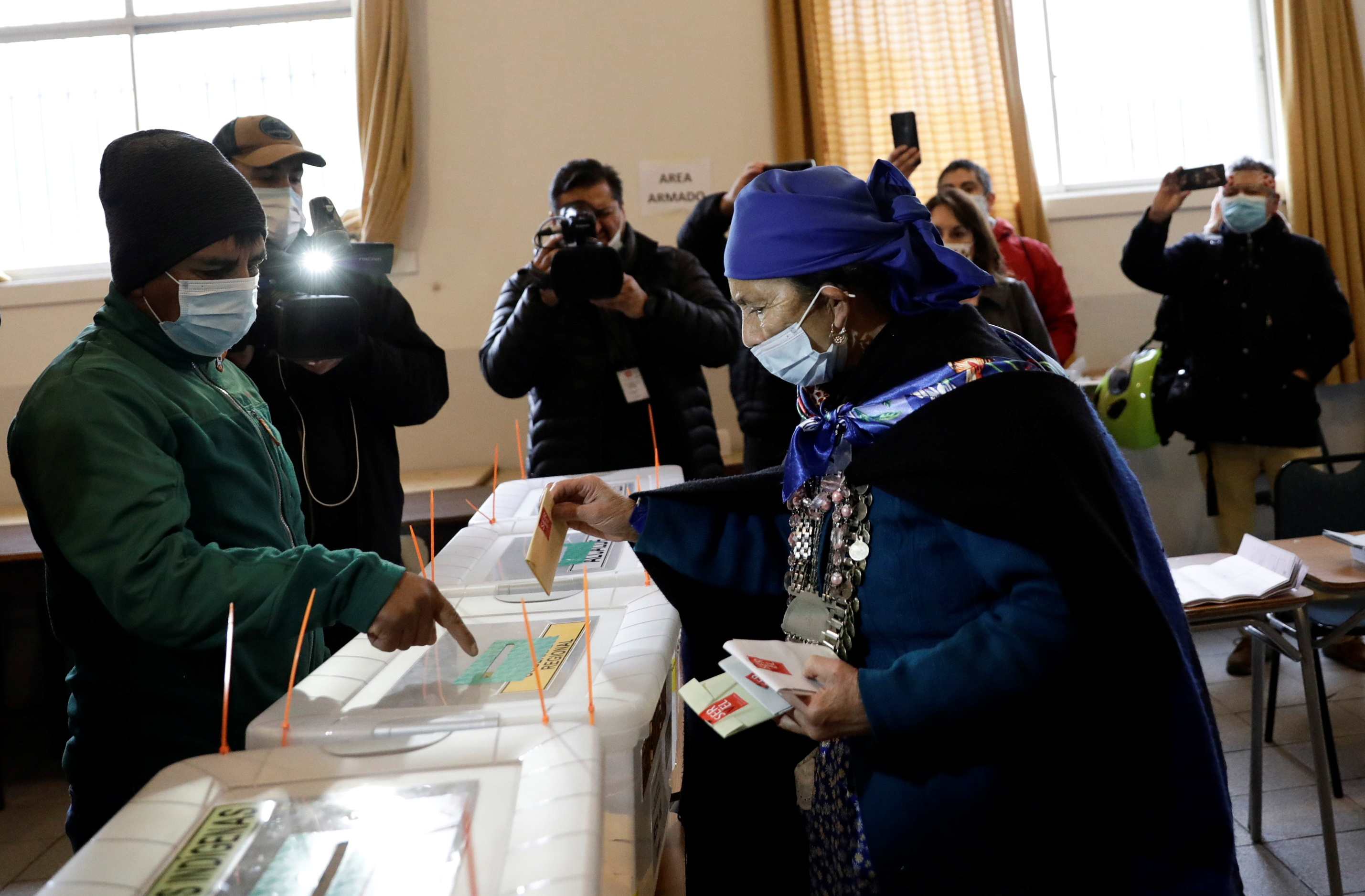 Mapuche spiritual authority and constituent candidate Francisca Linconao casts her vote in the election for governors, mayors, councillors and constitutional assembly members to draft a new constitution to replace Chile's charter, in Temuco, Chile May 16, 2021. REUTERS/Juan Gonzalez