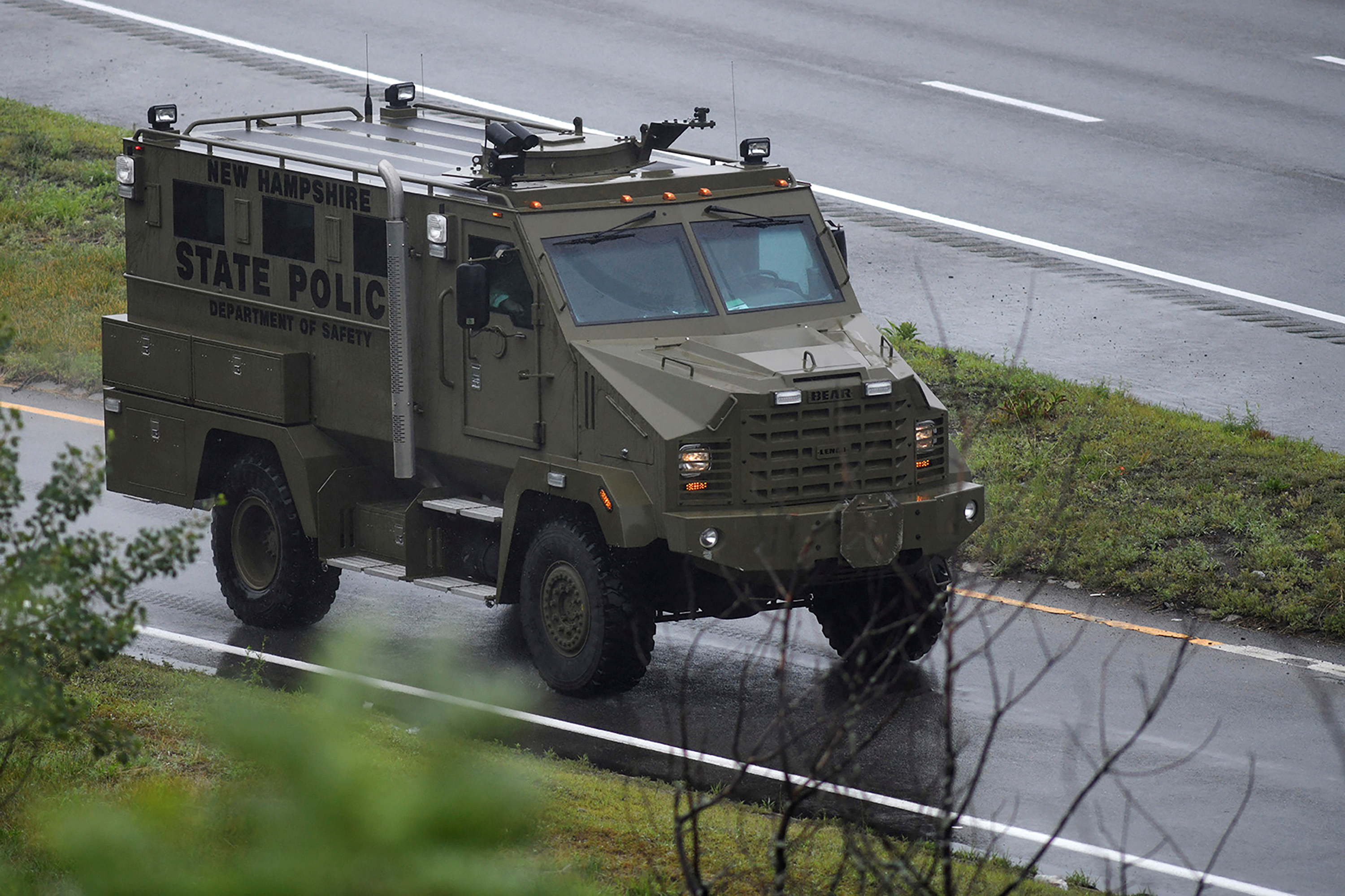 An armored police vehicle leaves the scene after state police announced they were conducting a search for armed persons following a traffic stop in Wakefield, Massachusetts, U.S. July 3, 2021.  REUTERS/Faith Ninivaggi
