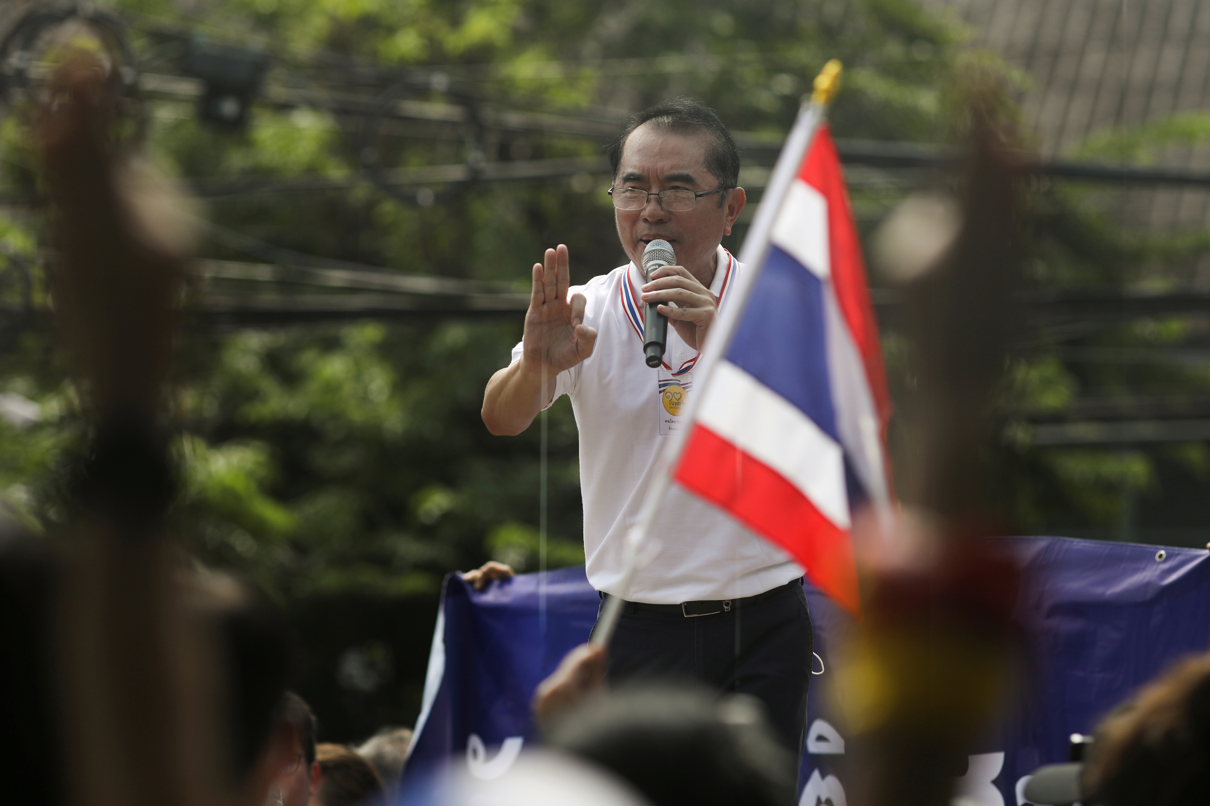 Warong Dechgitvigrom speaks during a protest by a group of royalists in front of parliament as they counter protest pro-democracy demonstrators and show support to the monarchy in Bangkok, Thailand September 23, 2020. REUTERS/Soe Zeya Tun/File Photo