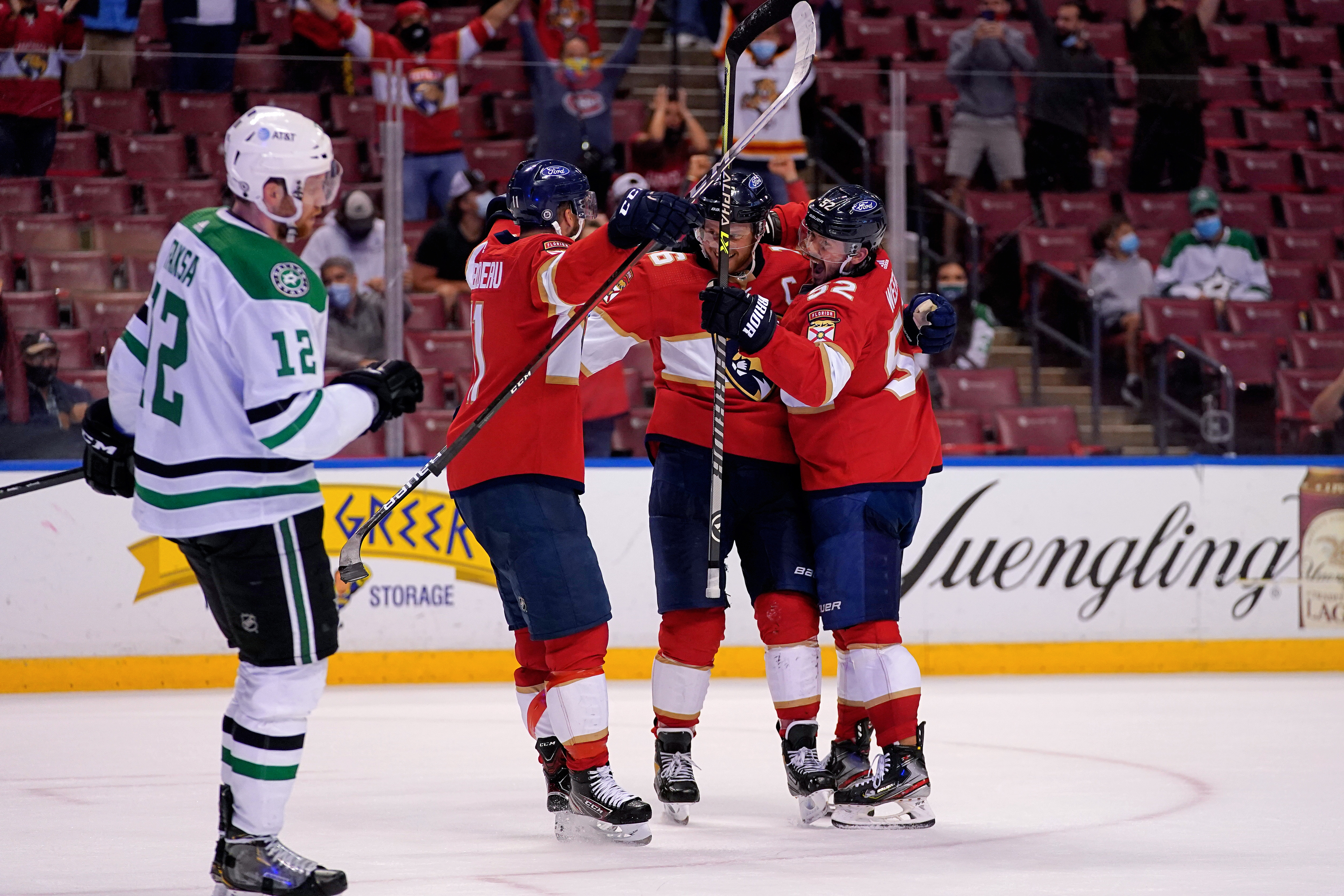 May 3, 2021; Sunrise, Florida, USA; Florida Panthers center Aleksander Barkov (16) celebrates with teammates after scoring the game winning goal in the overtime period against the Dallas Stars at BB&T Center. Mandatory Credit: Jasen Vinlove-USA TODAY Sports