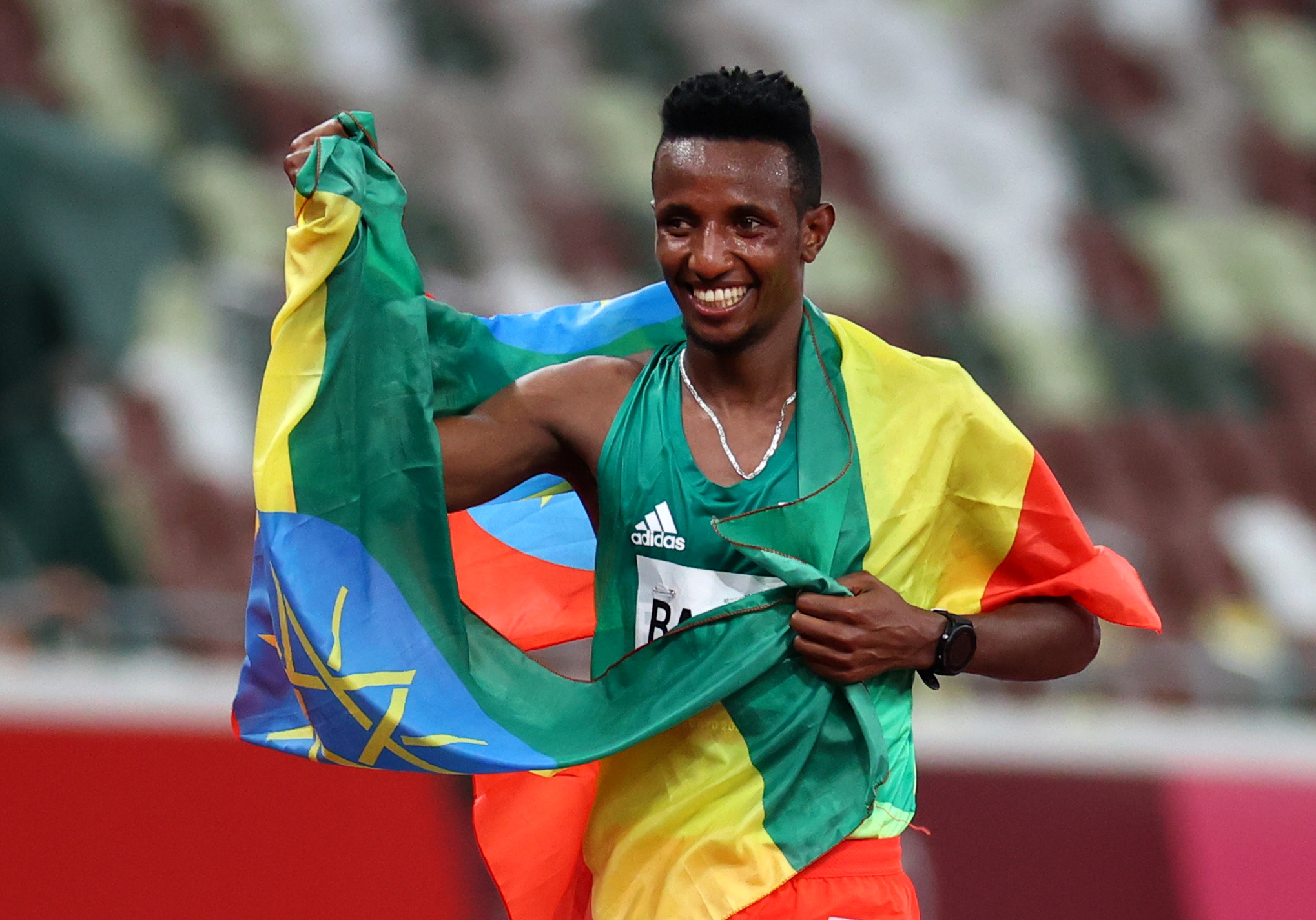 Tokyo 2020 Olympics - Athletics - Men's 10000m - OLS - Olympic Stadium, Tokyo, Japan - July 30, 2021. Selemon Barega of Ethiopia celebrates after winning the final REUTERS/Lucy Nicholson