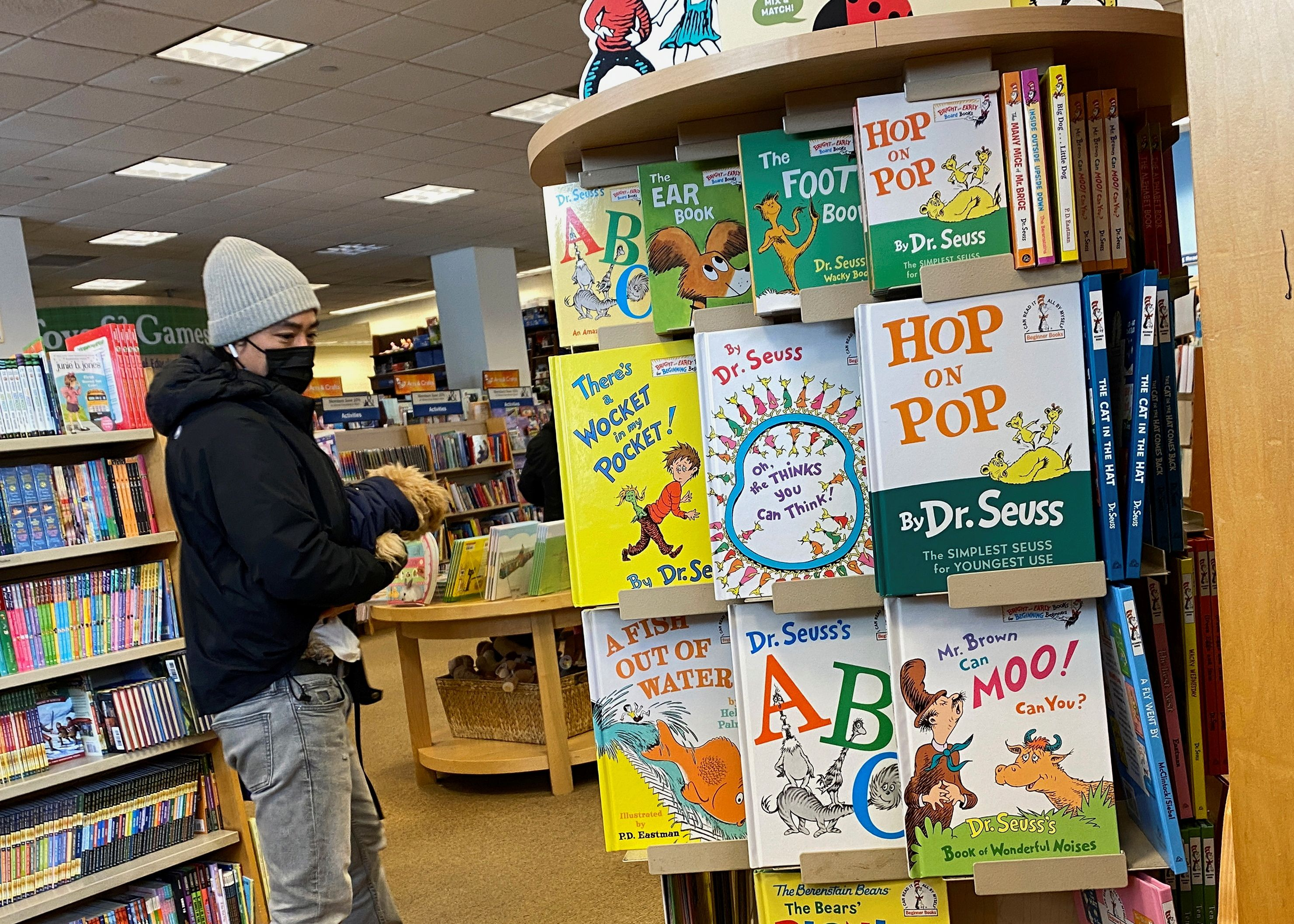 A customer looks at books by Dr. Seuss in a bookstore in Brooklyn, New York, U.S., March 2, 2021. REUTERS/Brendan McDermid