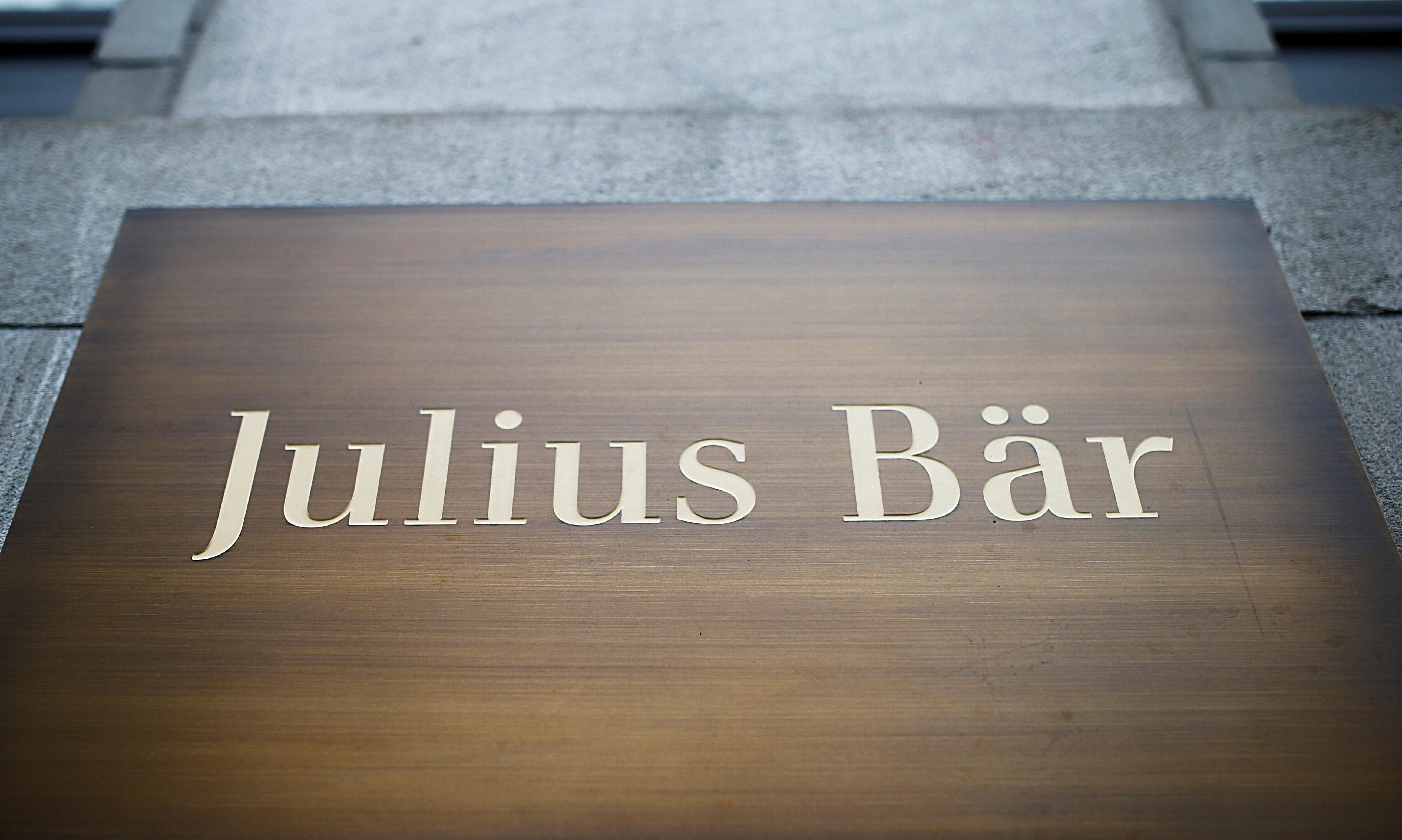 The logo of Swiss private bank Julius Baer is seen at a branch office in Zurich, Switzerland February 1, 2021.  REUTERS/Arnd Wiegmann/File Photo  GLOBAL BUSINESS WEEK AHEAD