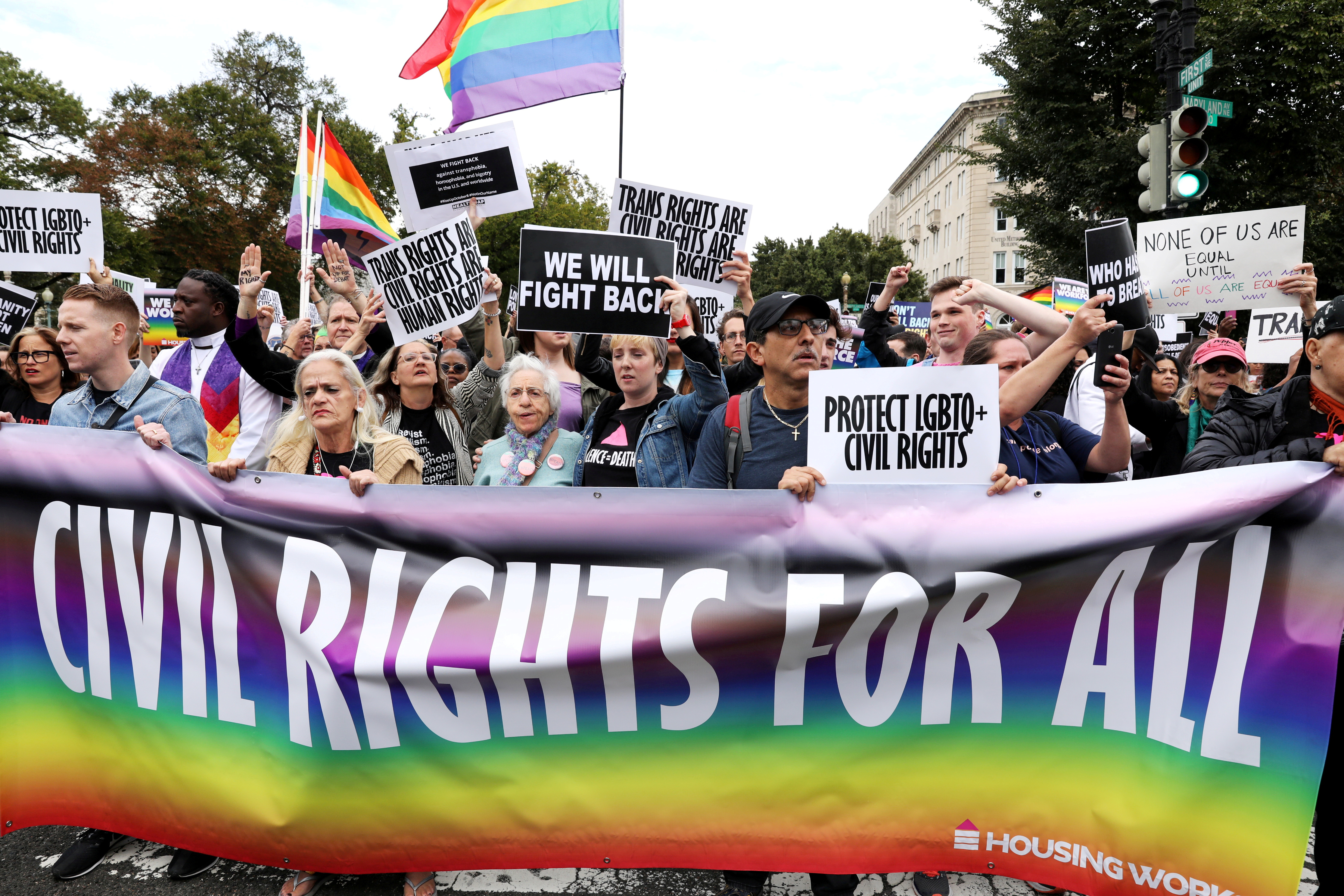 LGBT activists and supporters block the street outside the U.S. Supreme Court as it hears arguments in a major LGBT rights case on whether a federal anti-discrimination law that prohibits workplace discrimination on the basis of sex covers gay and transgender employees in Washington, U.S. October 8, 2019.  REUTERS/Jonathan Ernst/File Photo/File Photo