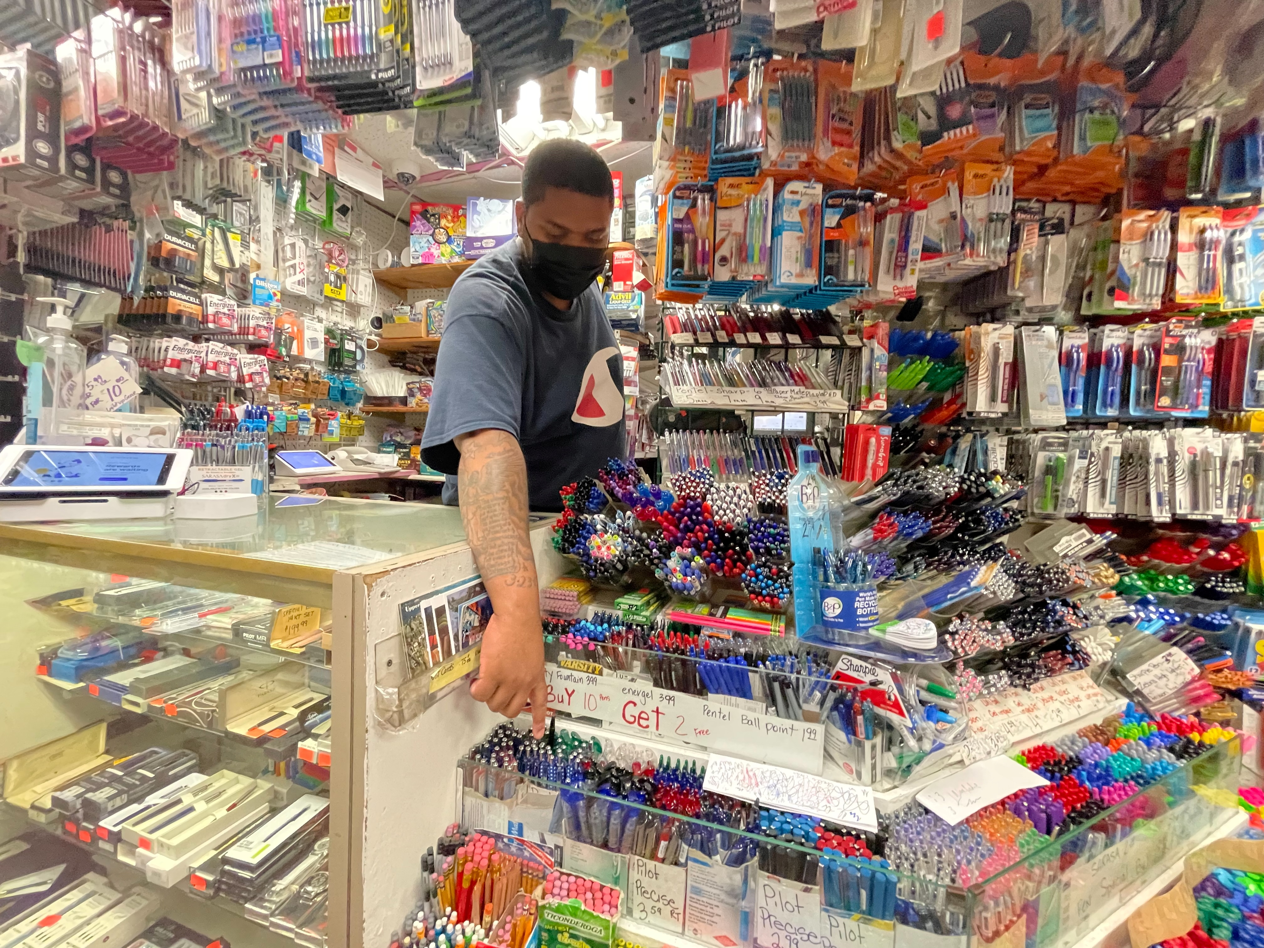 Staff member points to supplies on display at Stationery and Toy World in New York City, U.S., ahead of back-to-school season, July 21, 2021.REUTERS/Joyce Philippe