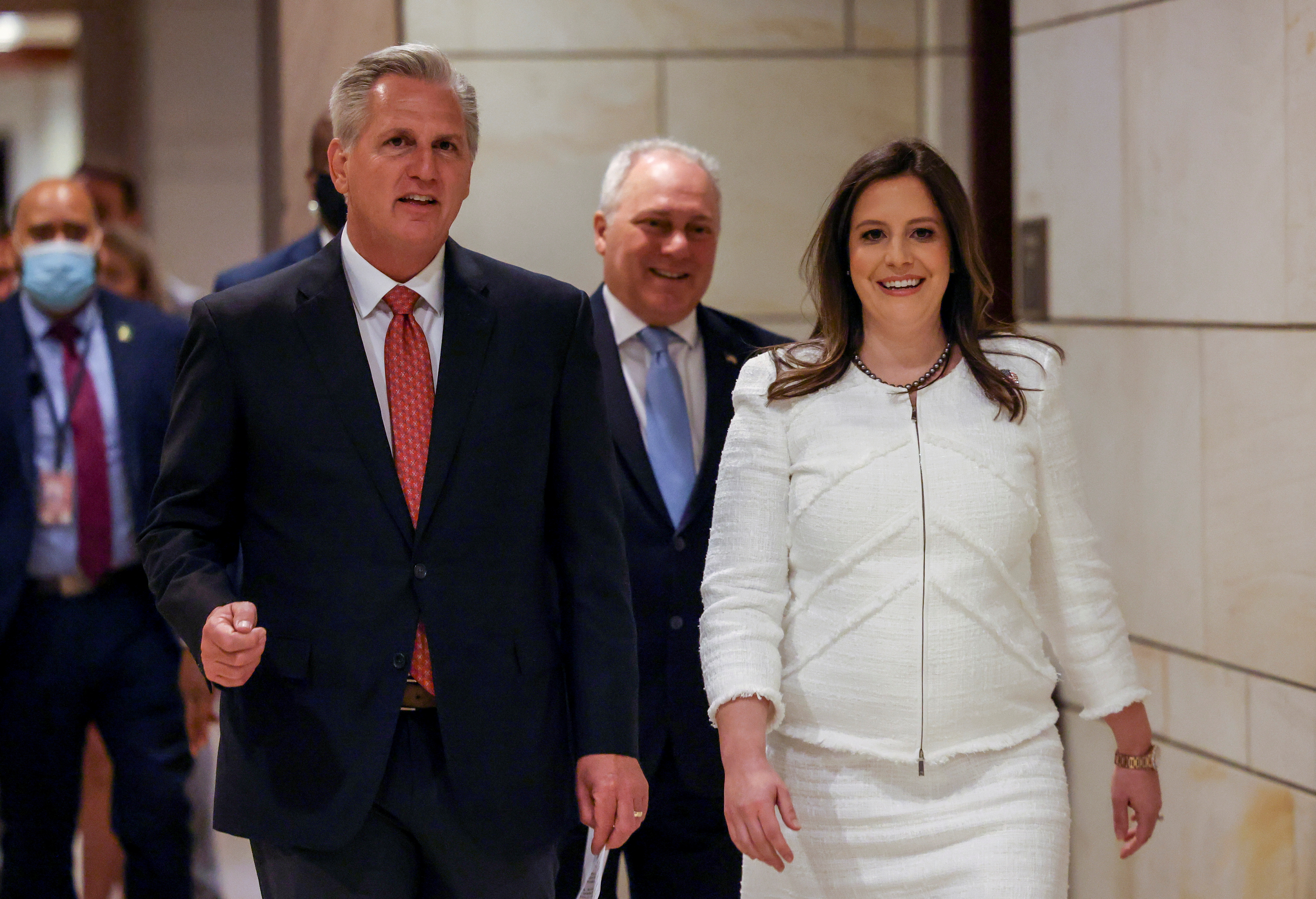 U.S. House Minority Leader Kevin McCarthy (R-CA) walks with U.S. Representative Elise Stefanik (R-NY) after the Republican caucus meeting to speak to the media, in Washington, U.S., May 14, 2021. REUTERS/Evelyn Hockstein