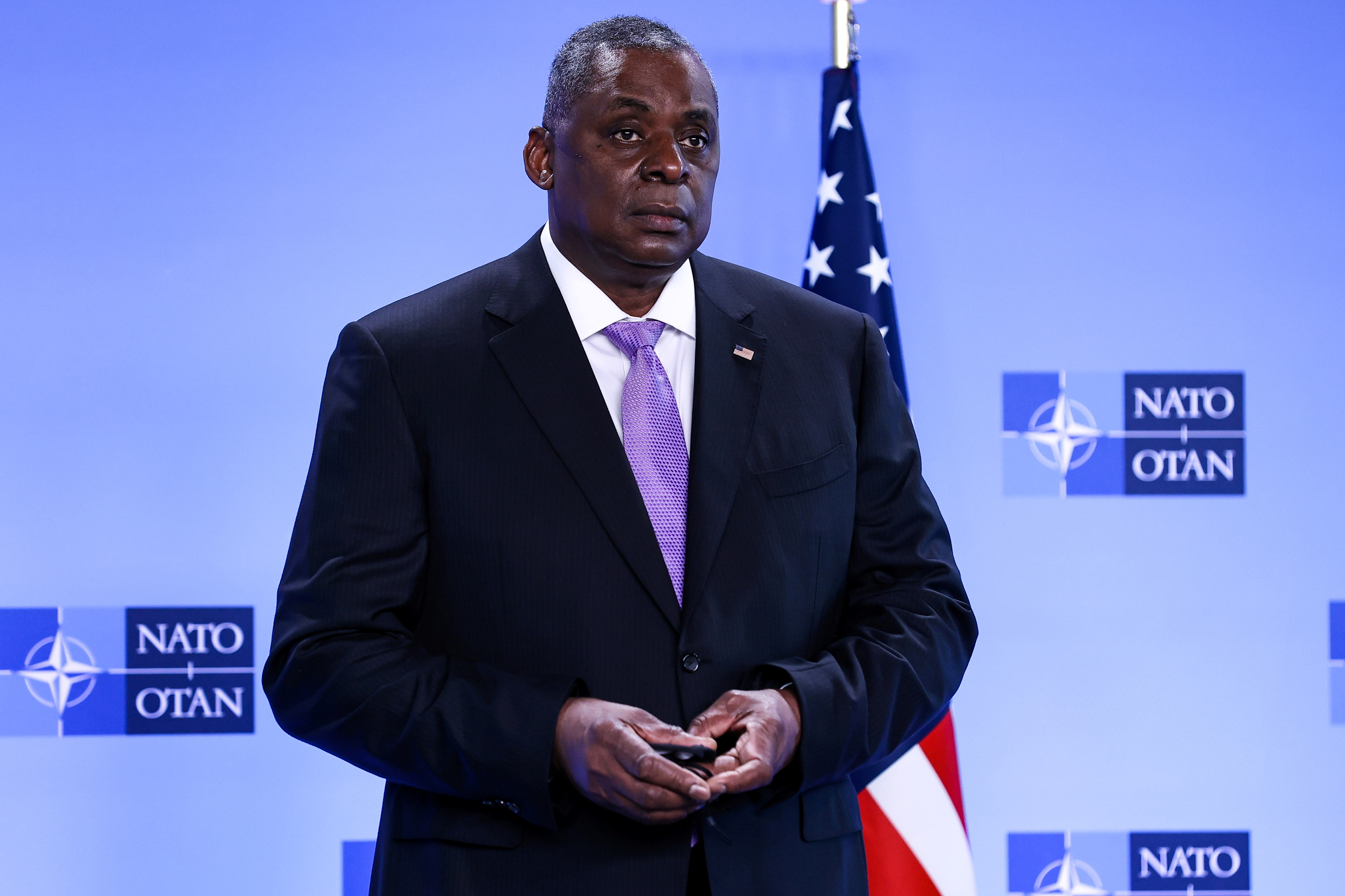 U.S. Defense Secretary Lloyd Austin looks on as he arrives for a meeting of foreign ministers of the U.S., Britain, France and Germany on Afghanistan at NATO's headquarters in Brussels, Belgium, April 14, 2021. Kenzo Tribouillard/Pool via Reuters