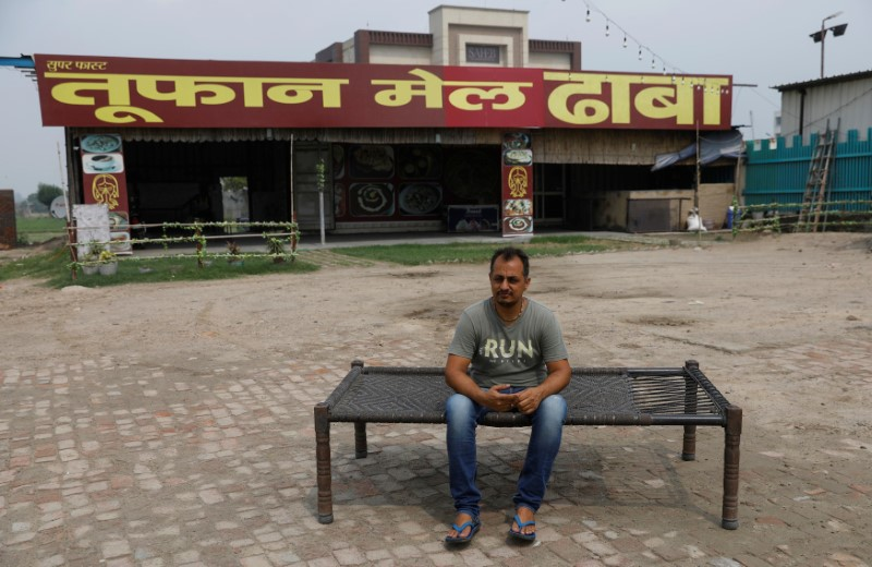 Vikas Malik, owner of a dhaba, a small restaurant, sits for a picture in front of his temporarily closed dhaba along a national highway in Murthal, in the northern state of Haryana, India, June 17, 2021. Picture taken on June 17, 2021. REUTERS/Adnan Abidi