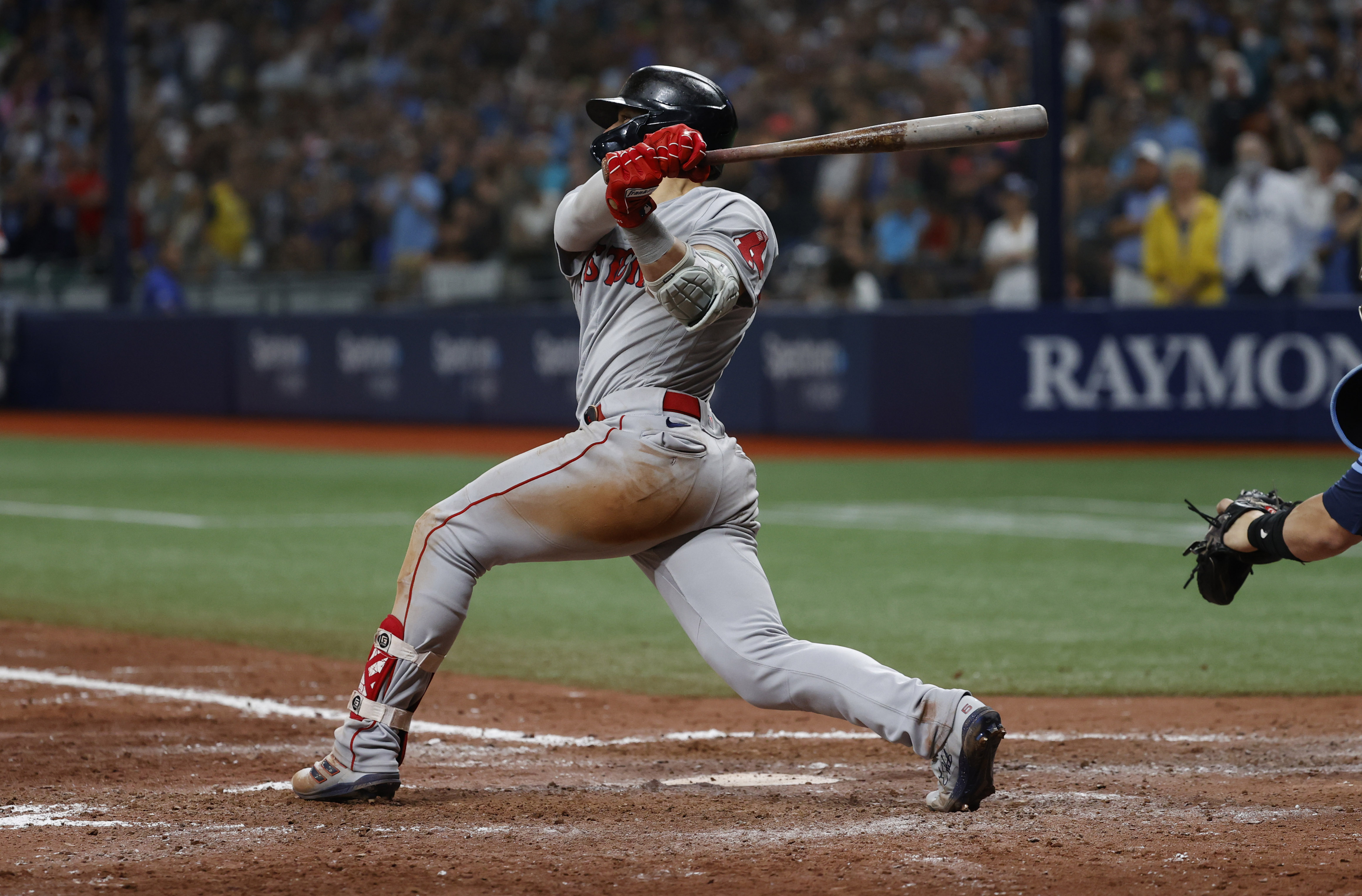 Aug 1, 2021; St. Petersburg, Florida, USA; Boston Red Sox center fielder Enrique Hernandez (5) singles during the ninth inning against the Tampa Bay Rays at Tropicana Field. Mandatory Credit: Kim Klement-USA TODAY Sports