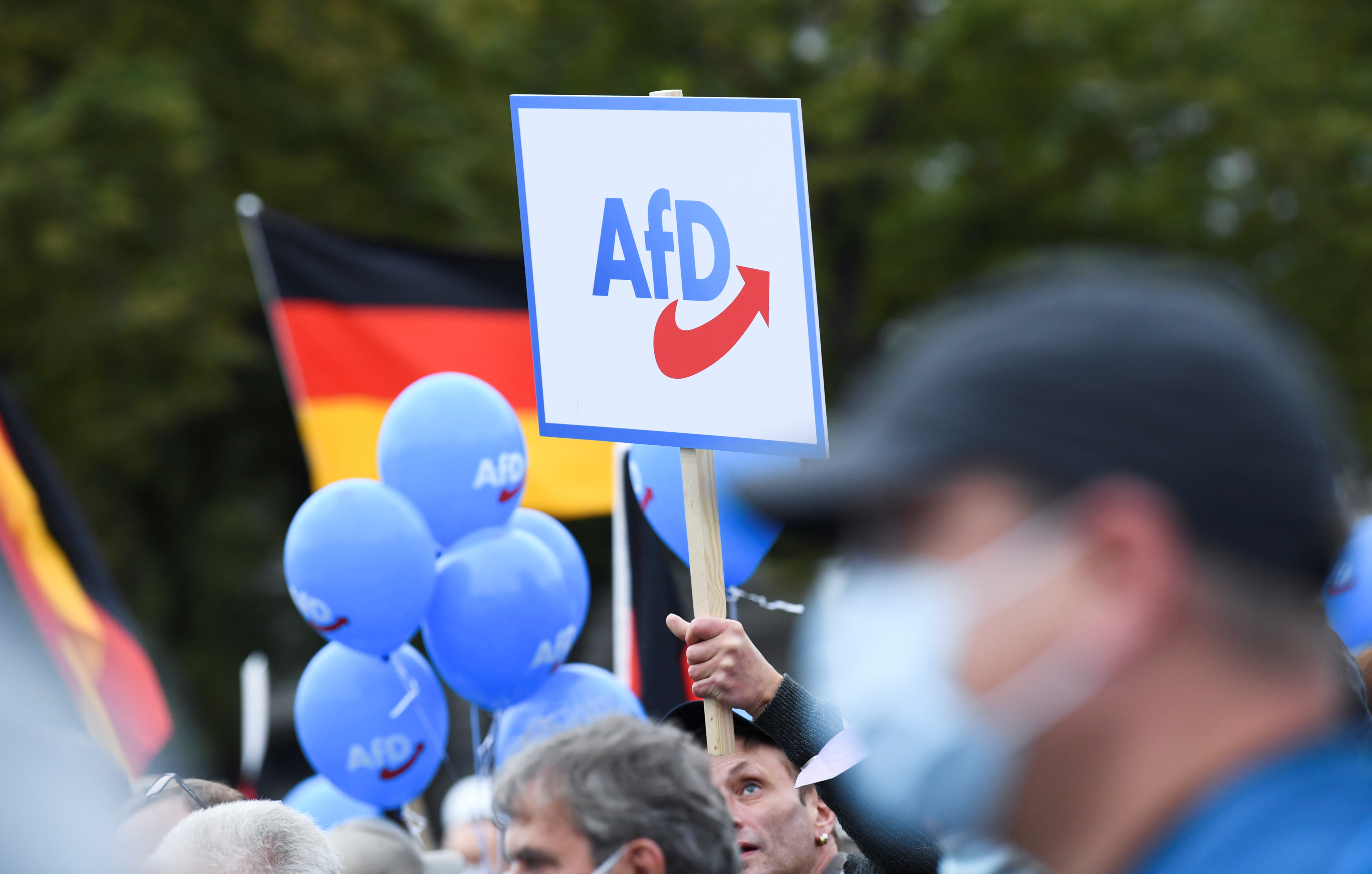Supporters hold balloons, flags and a placard during a campaign of right wing Alternative for Germany (AfD) top candidates for the upcoming general election, Alice Weidel and Tino Chrupalla, in Berlin, Germany, September 24, 2021. REUTERS/Annegret Hilse