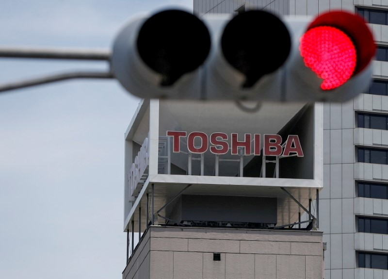 The logo of Toshiba Corp is seen near a traffic light in Tokyo, Japan June 11, 2021.  REUTERS/Issei Kato/File Photo