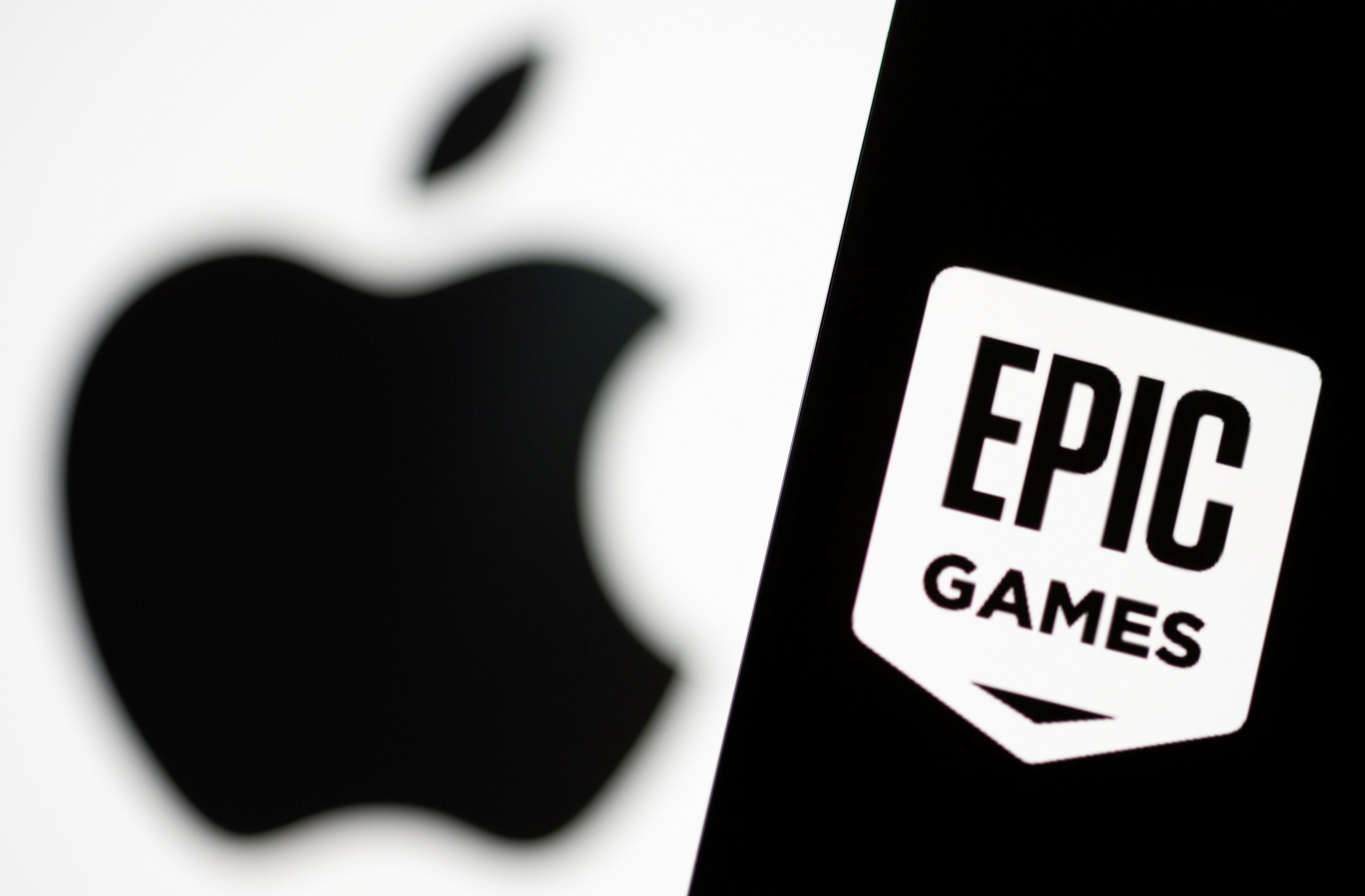 Smartphone with Epic Games logo is seen in front of Apple logo in this illustration taken, May 2, 2021. REUTERS/Dado Ruvic/Illustration/File Photo
