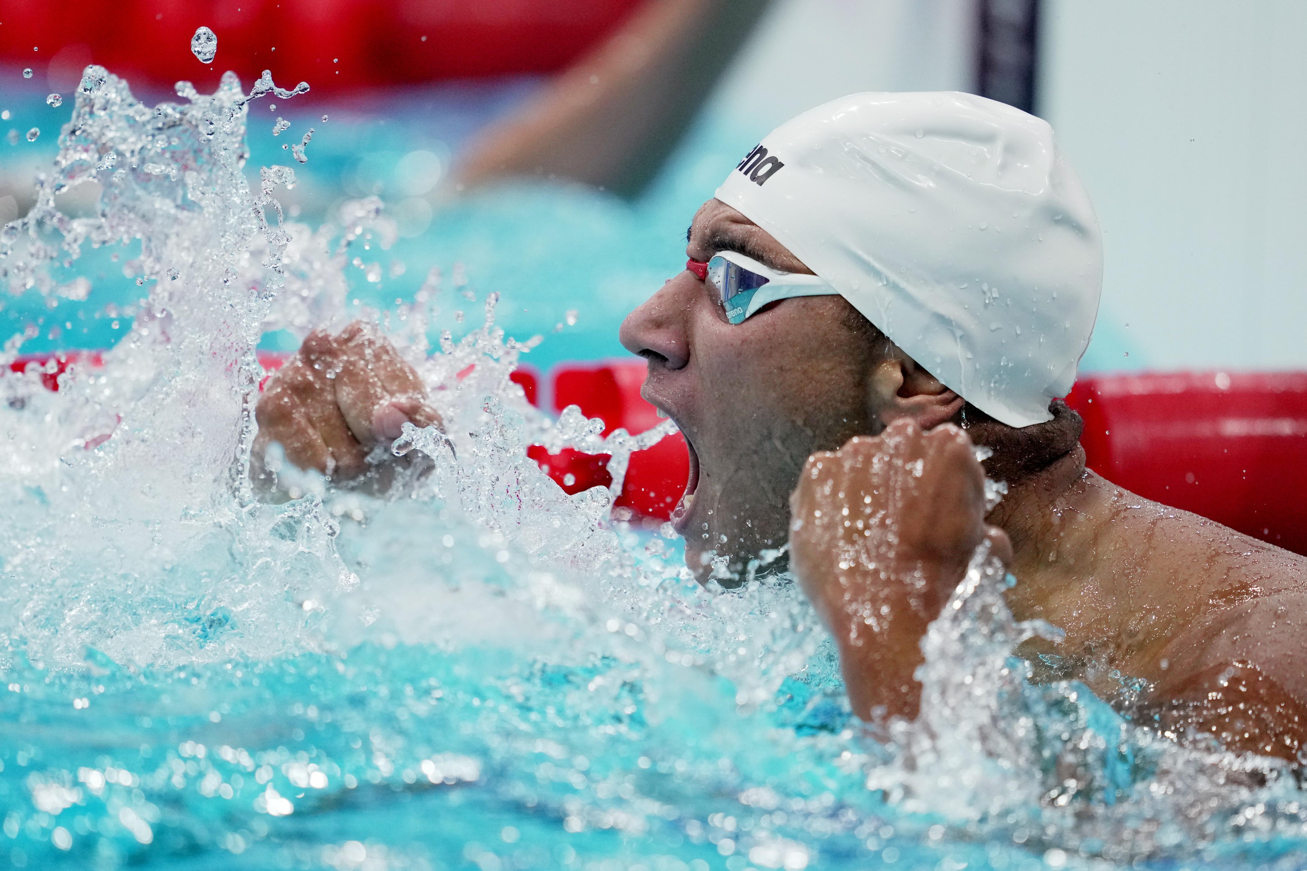 Tokyo 2020 Olympics - Swimming - Men's 400m Freestyle - Final - Tokyo Aquatics Centre - Tokyo, Japan - July 25, 2021. Ahmed Hafnaoui of Tunisia reacts after winning gold. REUTERS/Aleksandra Szmigiel