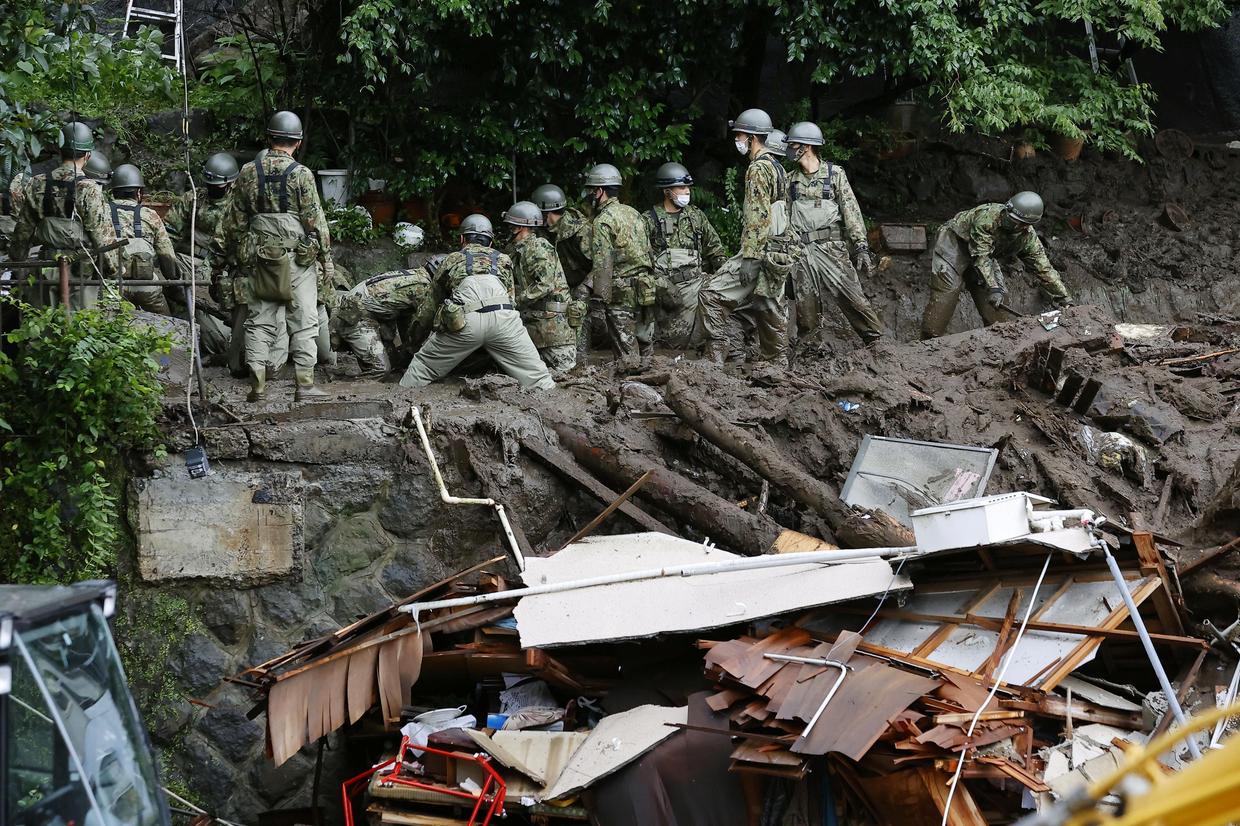 Rescuers in Japan hunt for 80 missing after deadly landslides | Reuters