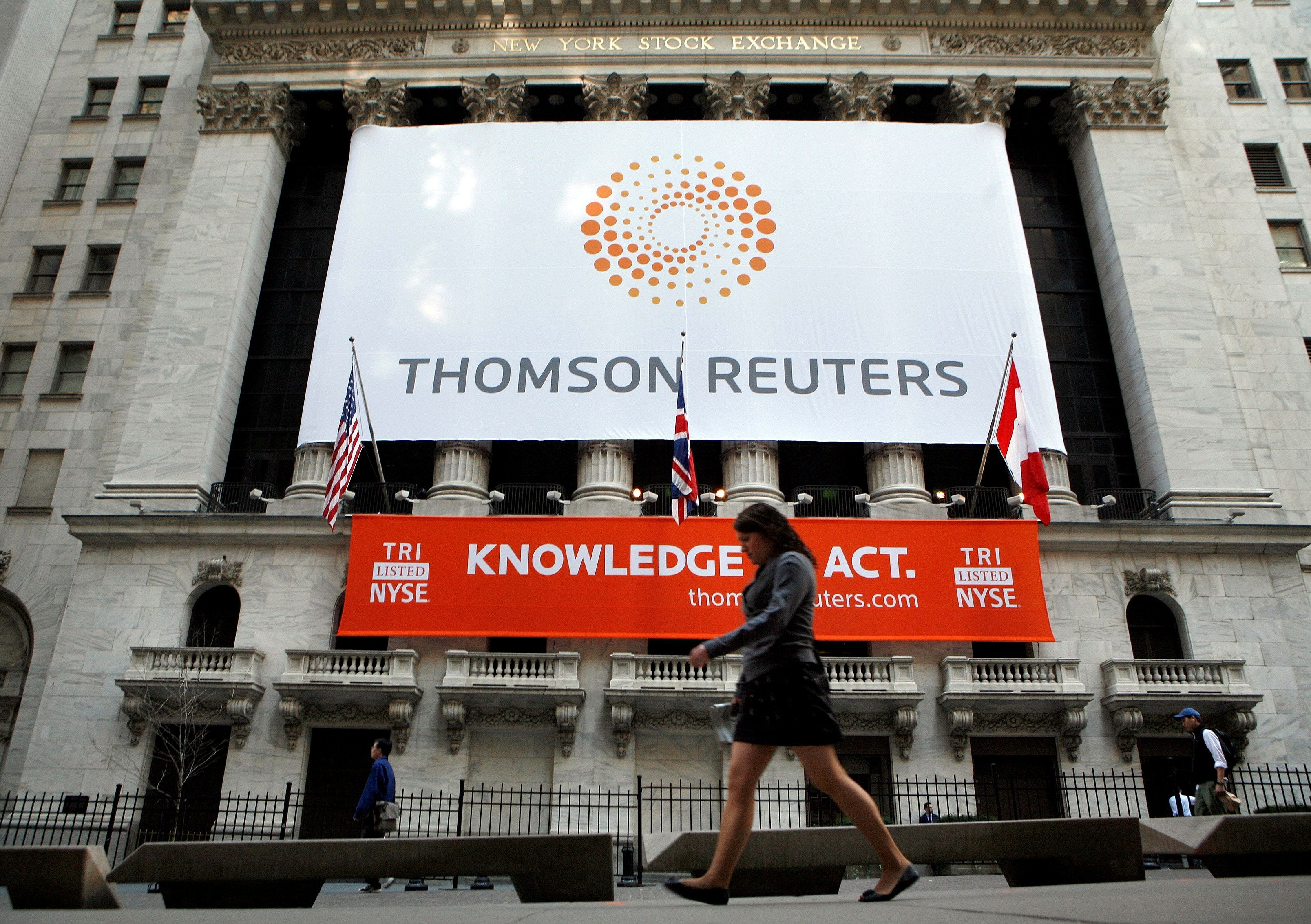 The front of The New York Stock Exchange displays the new Thomson Reuters logo as the stock is traded for the first time in New York April 17, 2008.     REUTERS/Brendan McDermid//File Photo