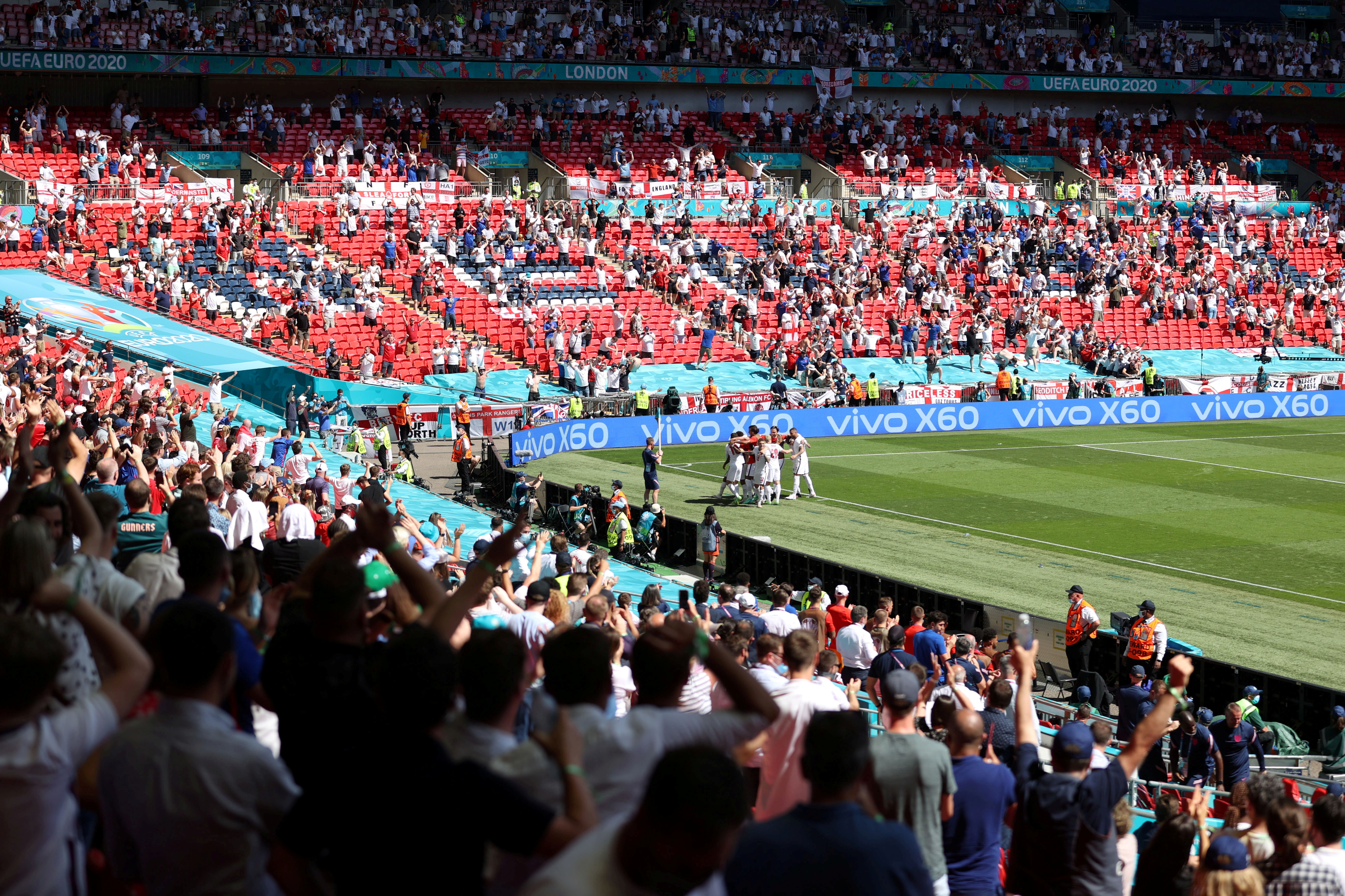 Soccer Football - Euro 2020 - Group D - England v Croatia - Wembley Stadium, London, Britain - June 13, 2021 General view as England's Raheem Sterling celebrates scoring their first goal with team mates and fans Pool via REUTERS/Catherine Ivill/File Photo