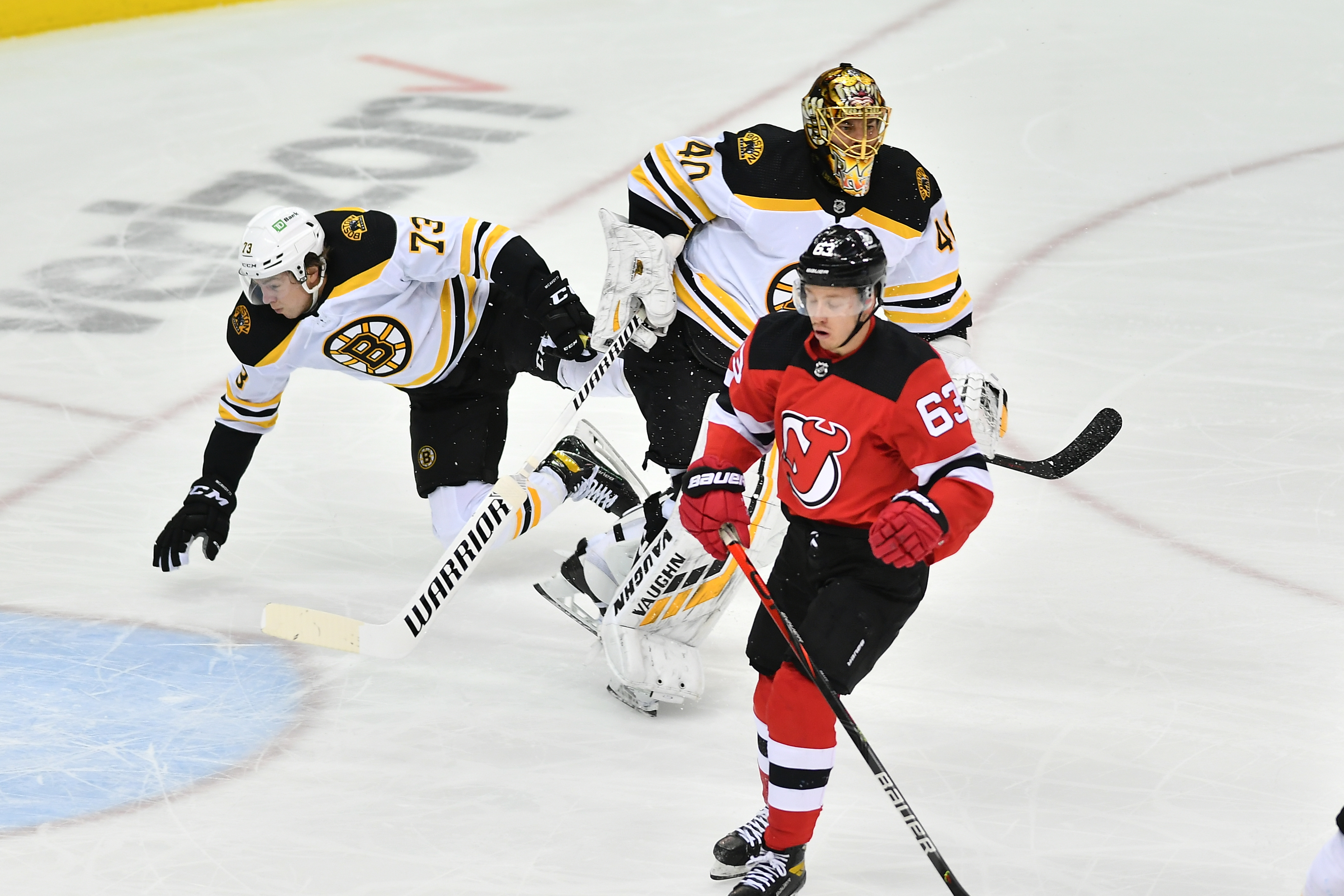 May 3, 2021; Newark, New Jersey, USA; Boston Bruins defenseman Charlie McAvoy (73) collides with Boston Bruins goalie Tuukka Rask (40) during a game against the New Jersey Devils in the first period at Prudential Center. Mandatory Credit: Catalina Fragoso-USA TODAY Sports