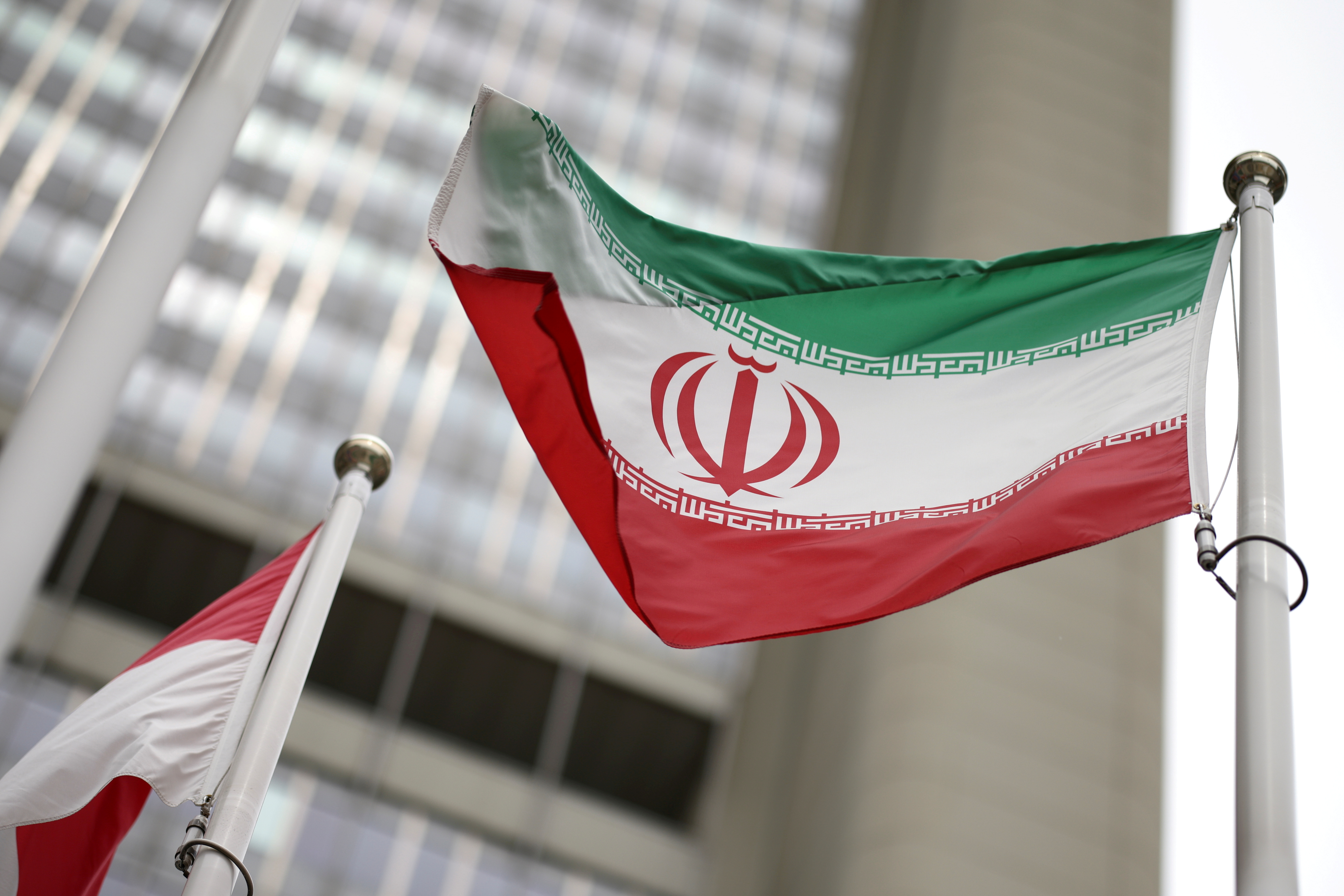 Iranian flag flies in front of the UN office building, housing IAEA headquarters, amid the coronavirus disease (COVID-19) pandemic, in Vienna, Austria, May 24, 2021. REUTERS/Lisi Niesner/File Photo