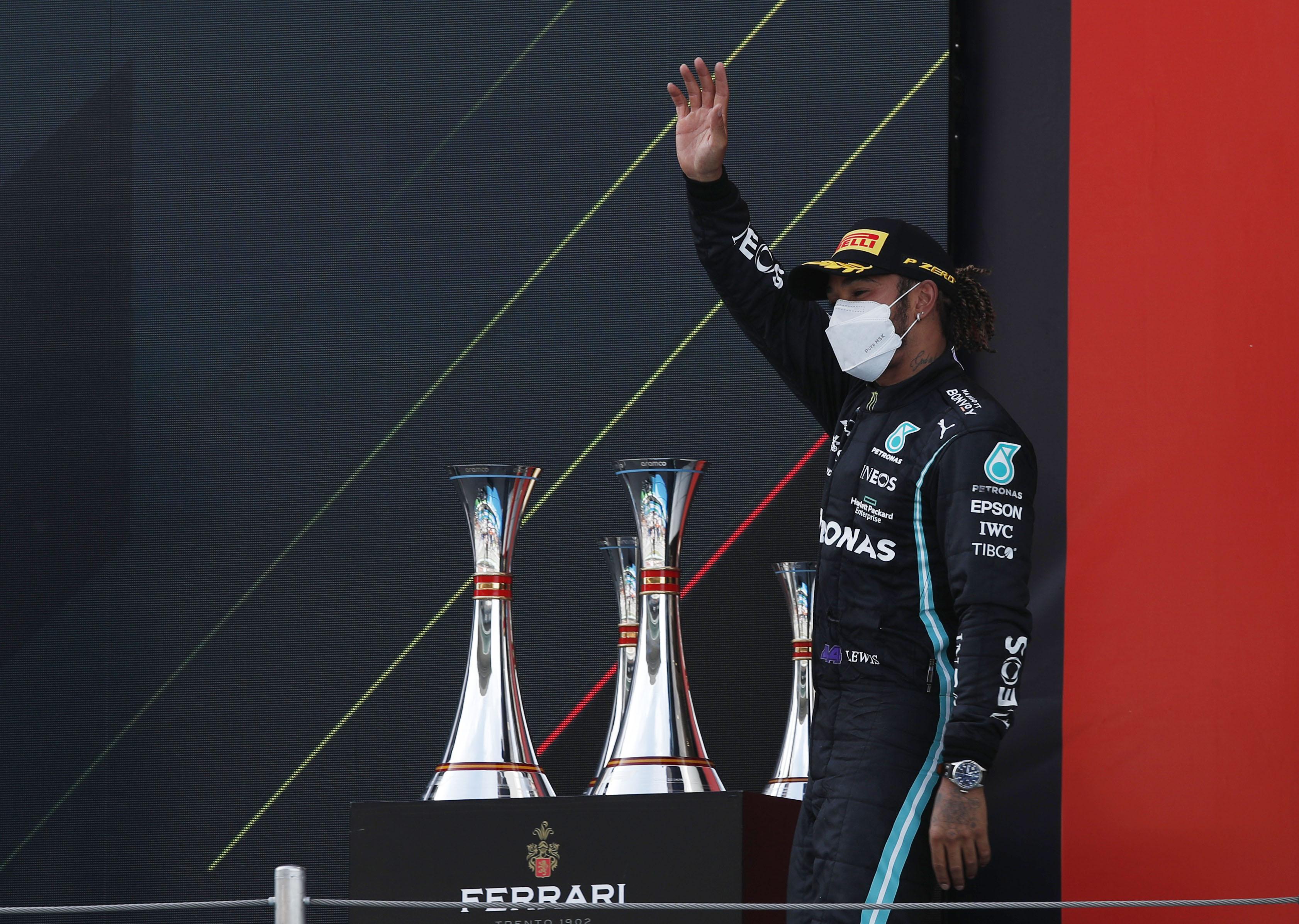 Formula One F1 - Spanish Grand Prix - Circuit de Barcelona-Catalunya, Barcelona, Spain - May 9, 2021 Mercedes' Lewis Hamilton celebrates on the podium after winning the race REUTERS/Albert Gea