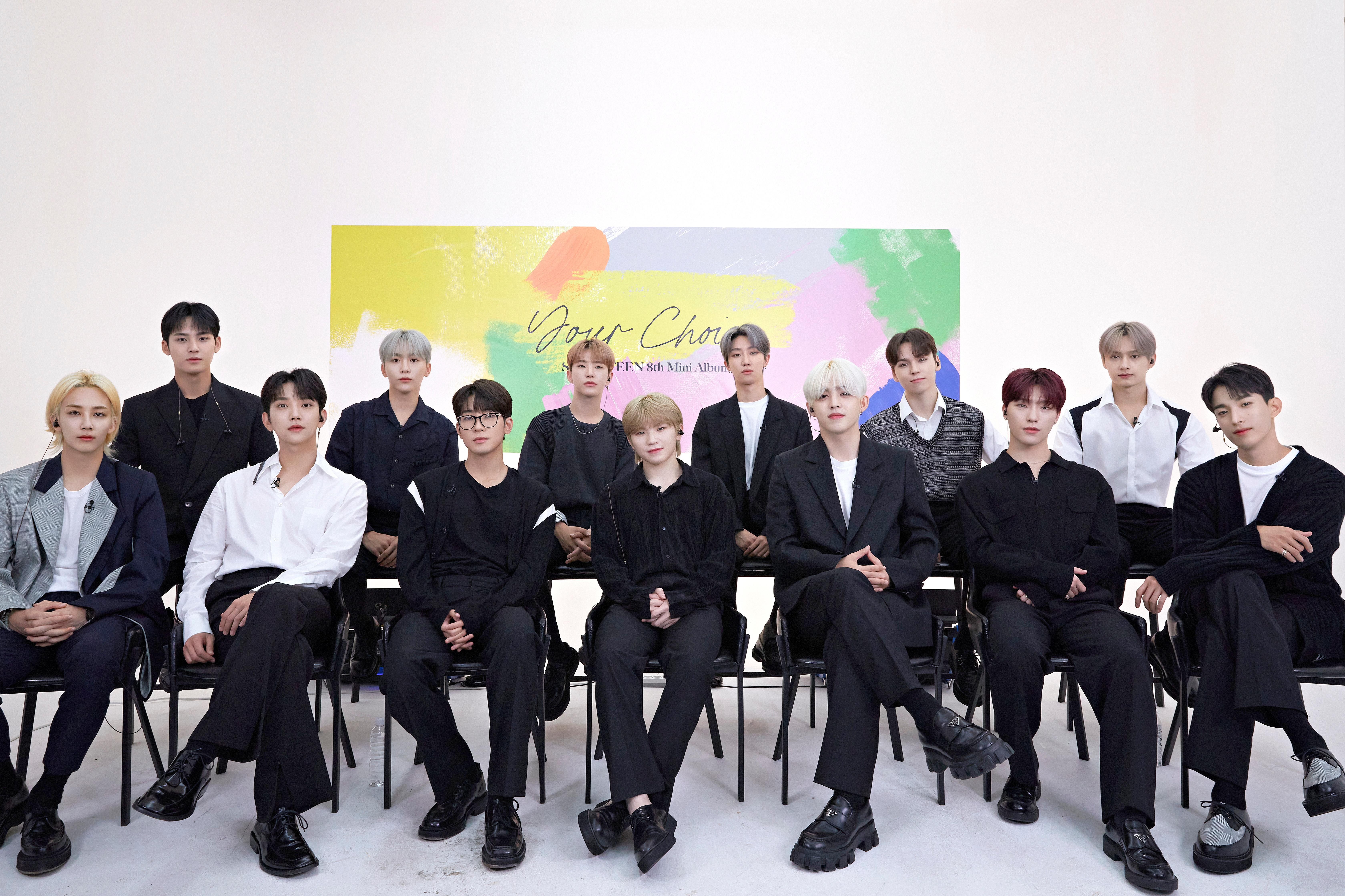 K-Pop group SEVENTEEN pose in this undated handout group photo. Top row (L to R) ? Mingyu, Seungkwan, Hoshi, The 8, Vernon, Jun. Bottom row (L to R) ? Jeonghan, Joshua, Wonwoo, Woozi, S.Coups, Dino, DK. Pledis Entertainment Co., Ltd./Handout via REUTERS