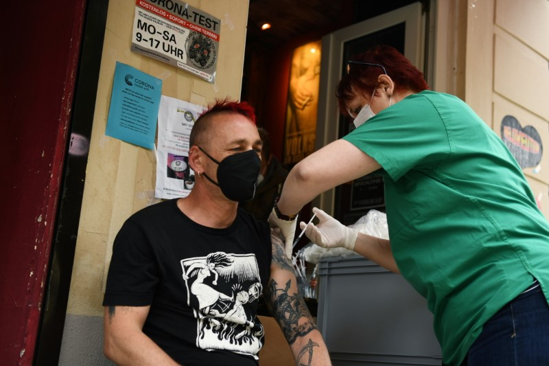 Pediatric nurse Jenny gives a Johnson & Johnson COVID-19 vaccine injection during vaccination at the Revolte Bar, which has been able to reopen after coronavirus disease (COVID-19) restrictions were eased, in Berlin, Germany June 13, 2021.  REUTERS/Annegret Hilse