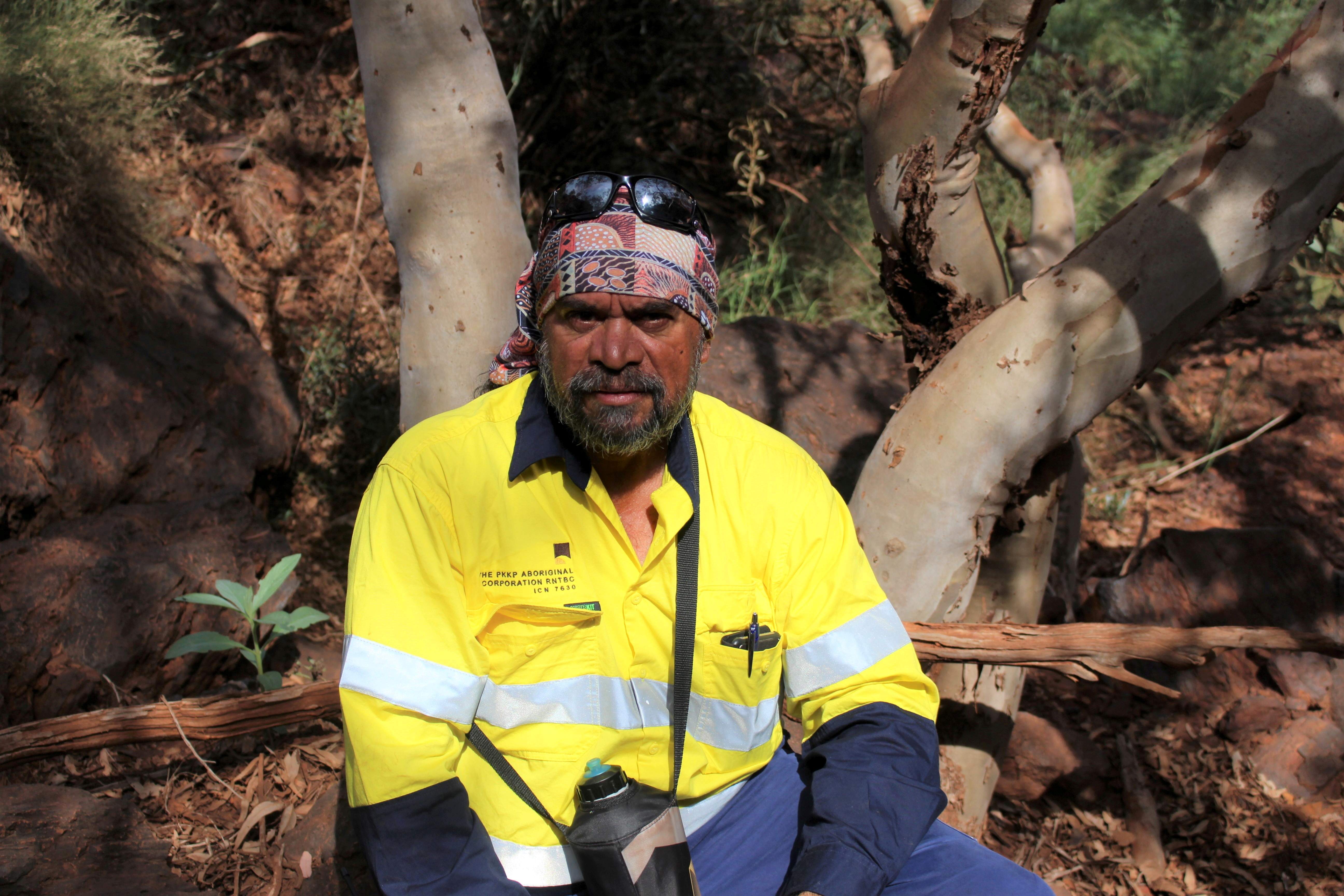 Puutu Kunti Kurrama and Pinikura (PKKP) Director and Puutu Kunti Kurruma Land Committee Chairperson Burchell Hayes poses in the Pilbara region of Western Australia, May 10, 2021.   Puutu Kunti Kurrama and Pinikura (PKKP)/Handout via REUTERS