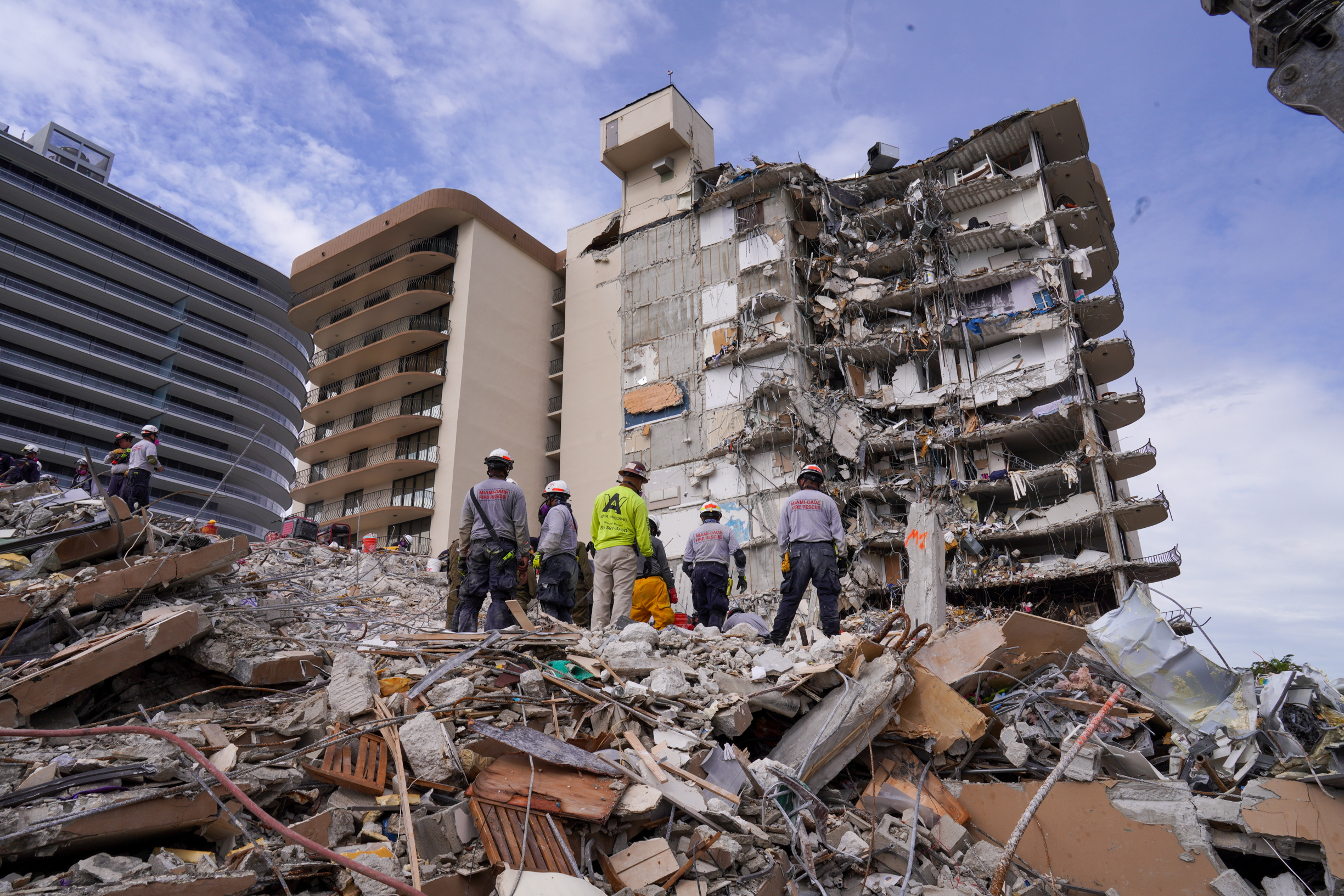 Search and rescue personnel work at the site of a collapsed Florida condominium complex in Surfside, Miami, U.S., in this handout image July 2, 2021. MIAMI DADE FIRE DEPARTMENT/Handout via REUTERS