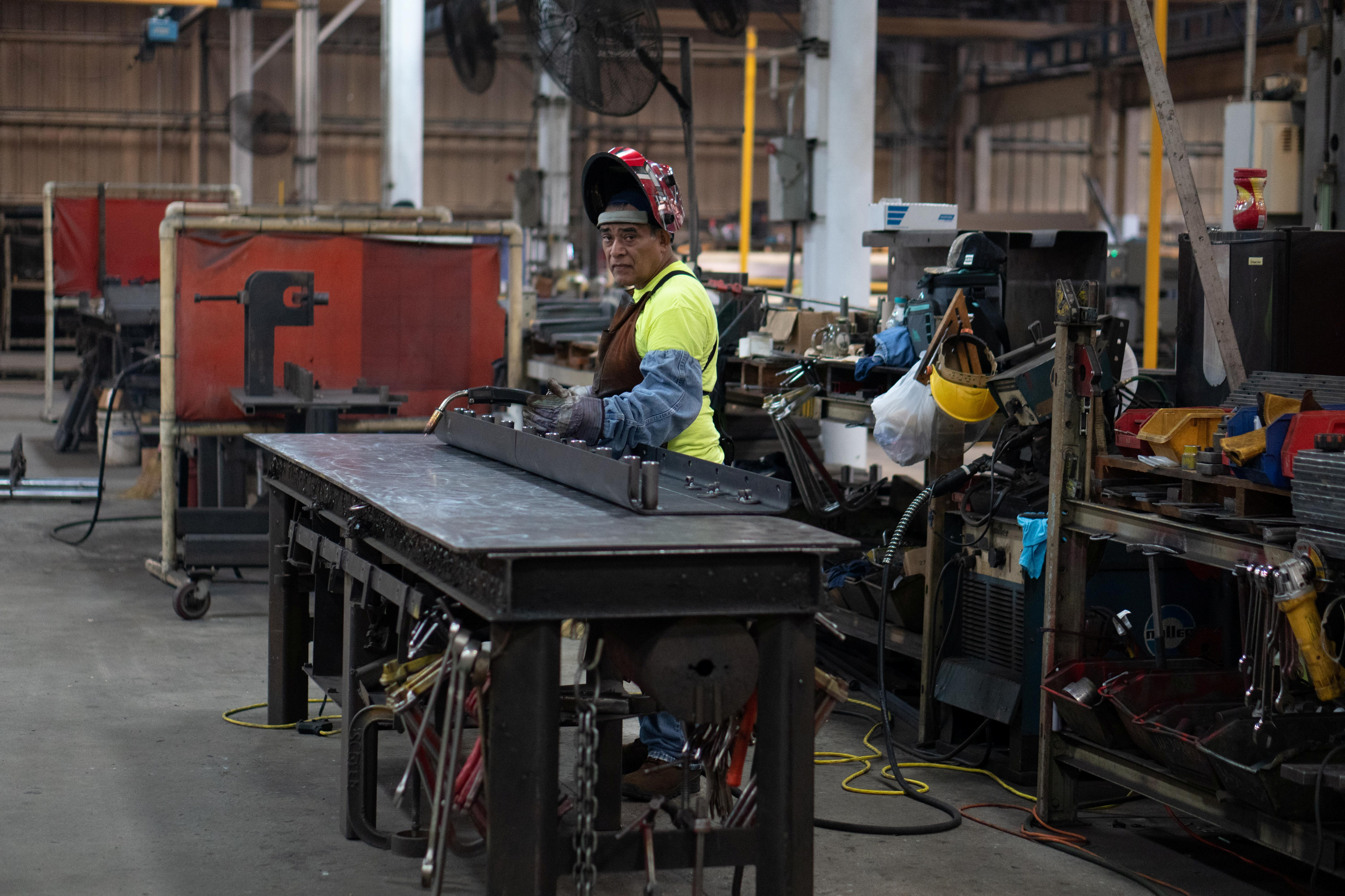 A worker welds a screed wear plate at the Calder Brothers' facility in Taylors, South Carolina, U.S., July 19, 2021. Picture taken July 19, 2021. Brandon Granger/Calder Brothers Corporation/Handout via REUTERS