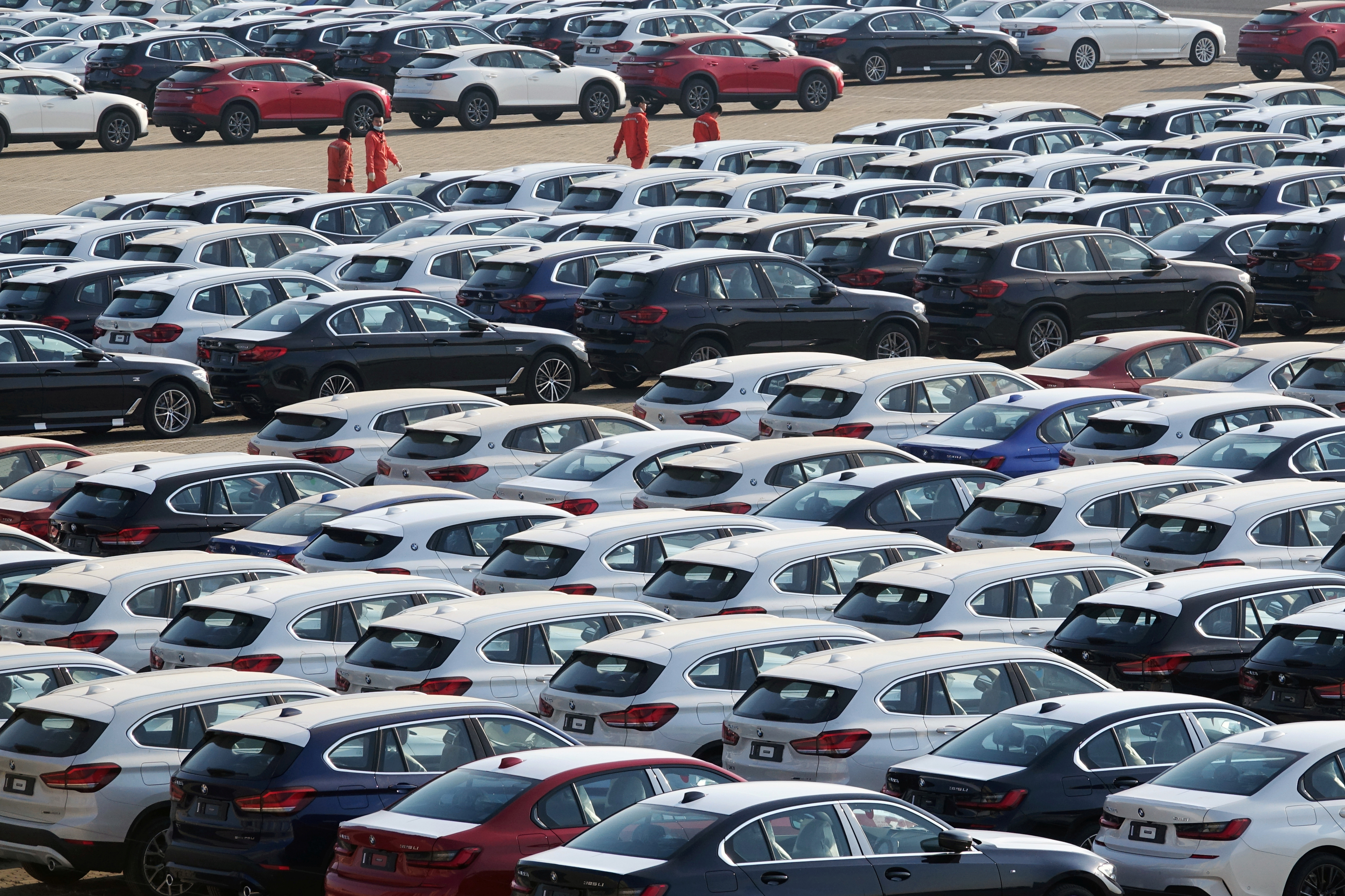 Newly manufactured cars are seen at a port in Dalian, Liaoning province, China April 10, 2020. China Daily via REUTERS/Files